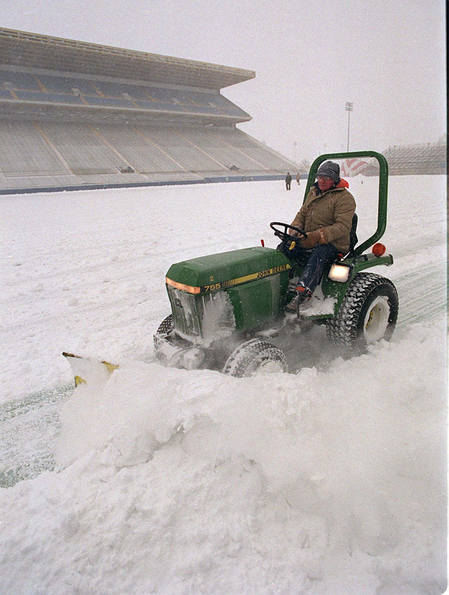 Winnipeg Free Press Files</p><p>Grounds crew members clear the field at Winnipeg Stadium in the lead up to the Grey Cup final in 1991.</p>