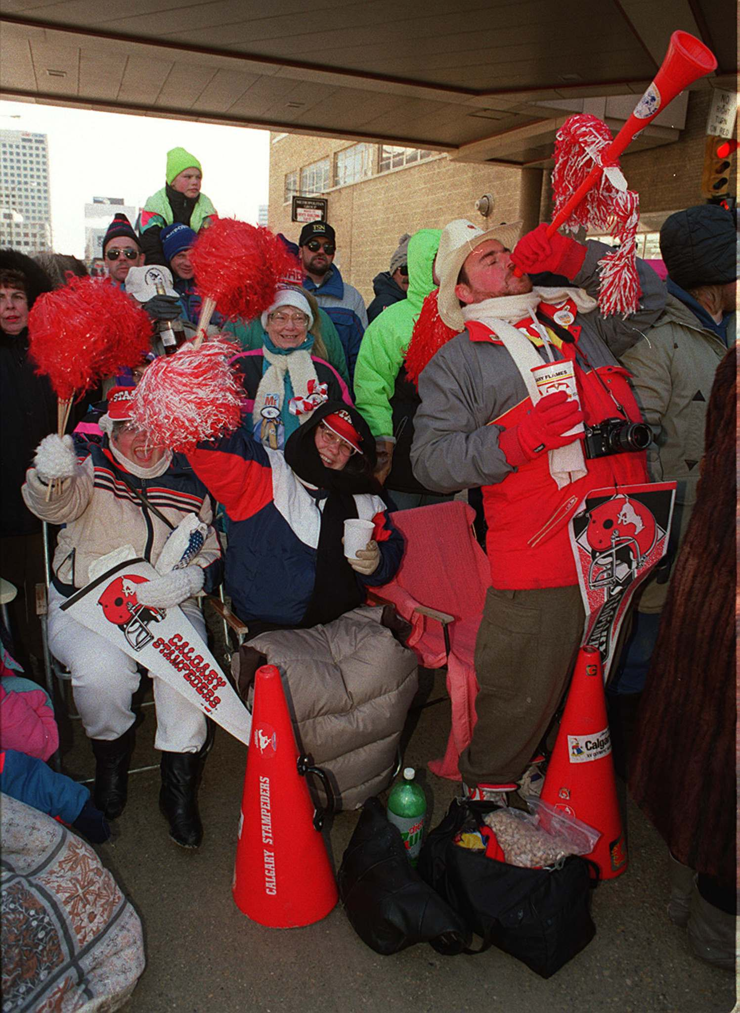 Winnipeg Free Press Files</p><p>Football fans take part in the Grey Cup parade on Portage Avenue in 1991.</p>