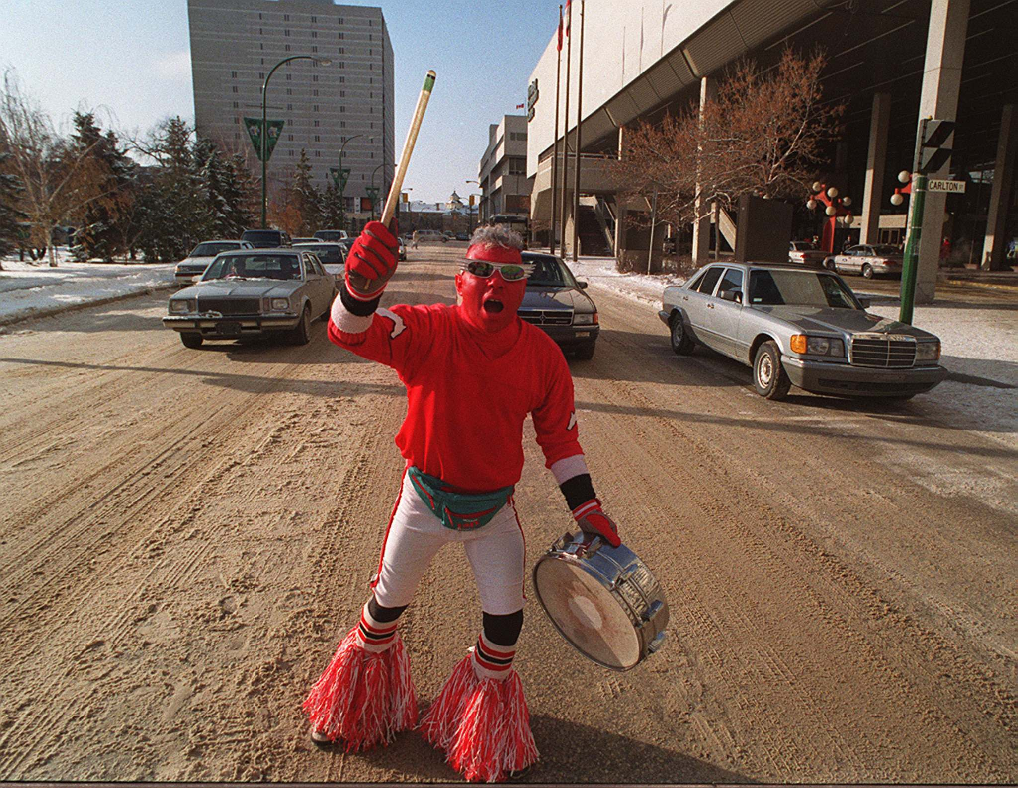 Winnipeg Free Press Files</p><p>A Calgary Stampeders fans bangs his drum in downtown Winnipeg during the lead up to the Grey Cup final in Winnipeg in 1991.</p>