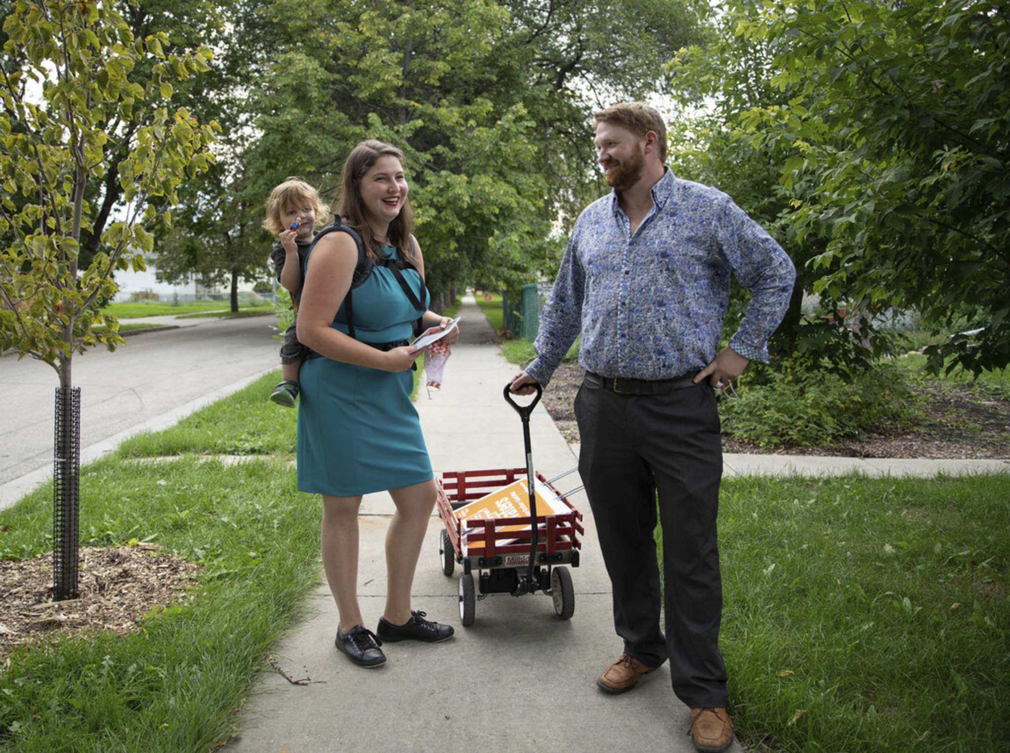 JESSICA LEE/WINNIPEG FREE PRESS</p><p>NDP candidate Meghan Waters canvasses with her son Léon and husban, Ryan Palmquist on Friday.</p>