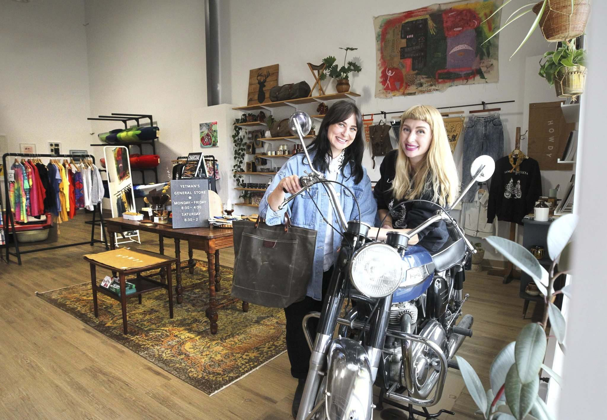 Kristen (right) and Megan in their new boutique store, which features a 1967 Norton Atlas motorcycle. (Ruth Bonneville / Winnipeg Free Press)</p>