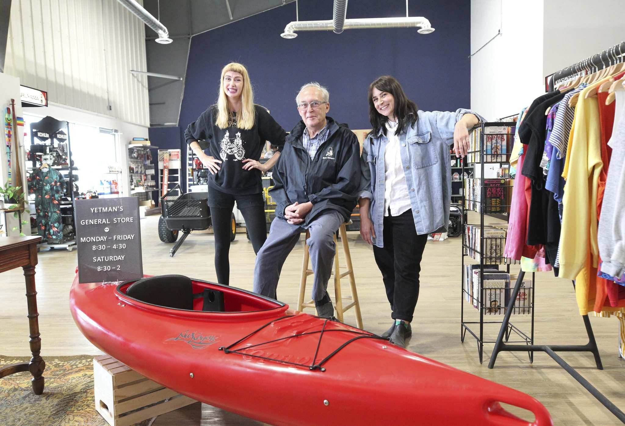 Owner Norm Yetman with daughters Kristen Yetman (left) and Megan Yetman in their store. Norm and his brother, Keith Yetman, own the store and Norm's daughters manage the new boutique inside the store. (Ruth Bonneville / Winnipeg Free Press)</p>