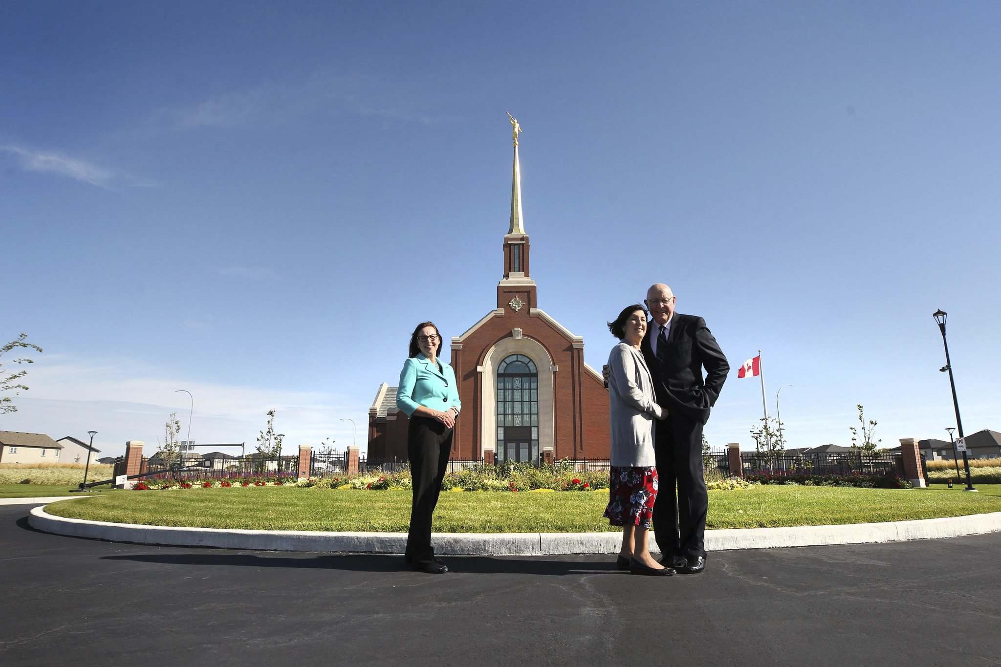 RUTH BONNEVILLE / WINNIPEG FREE PRESS</p><p>Christine Baronins and Allan and Yvonne Robison stand outside the new temple at 15 Centre St., situated on the meridian between south and north bound lanes of Kenaston Boulevard.</p></p>