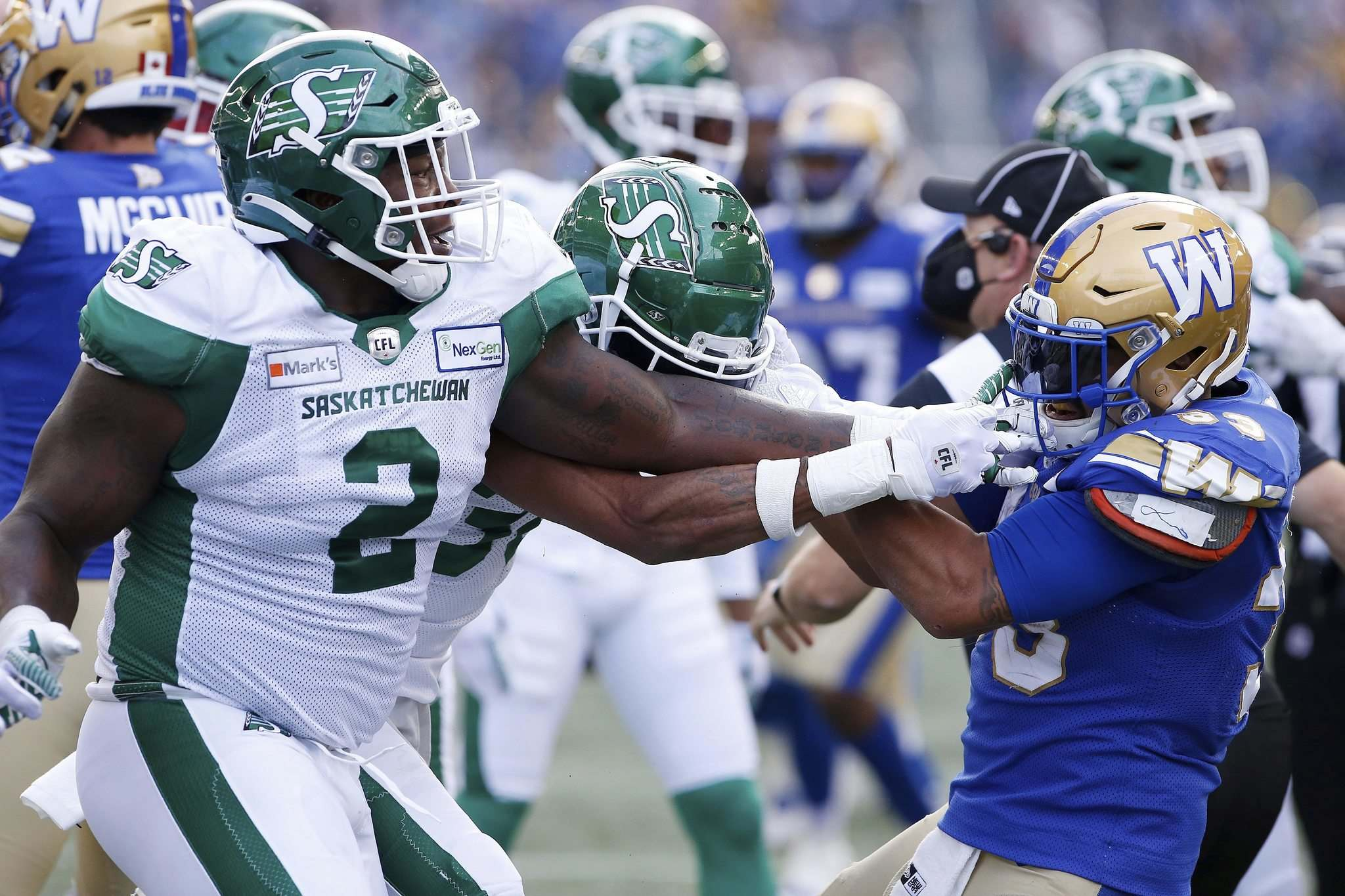 John Woods / The Canadian Press</p><p>Winnipeg Blue Bombers' Andrew Harris, right, fights with Saskatchewan Roughriders players during the first half of the Banjo Bowl, Saturday.</p>