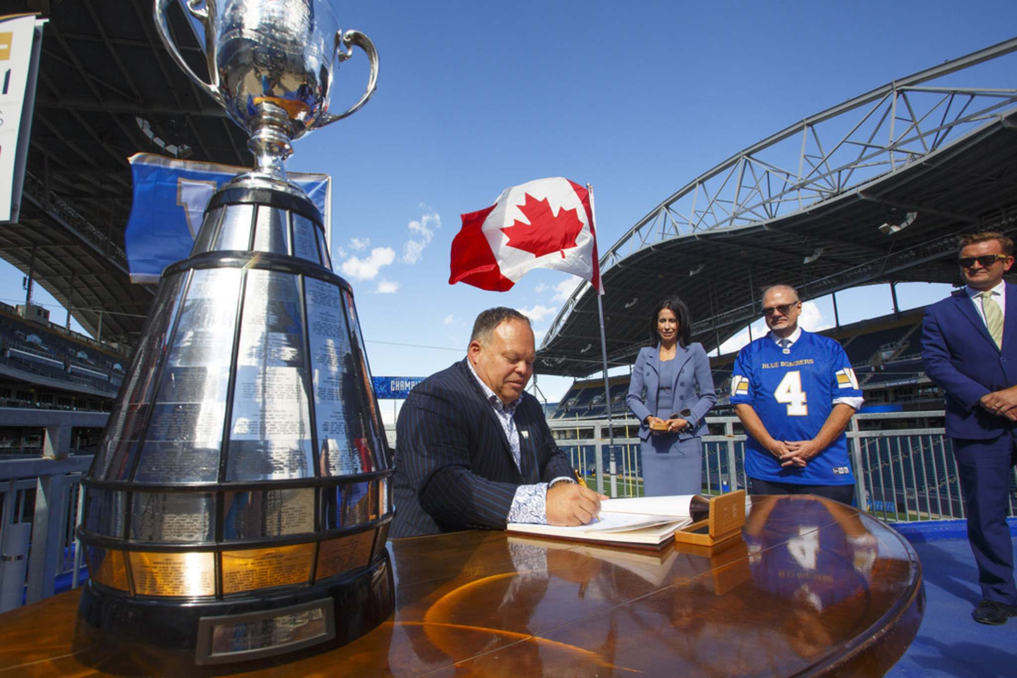 MIKE DEAL / WINNIPEG FREE PRESS</p><p>Premier Kelvin Goertzen, Wade Miller, president and CEO, Winnipeg Football Club and Dayna Spiring, chair, board of directors, Winnipeg Football Club, along with other dignitaries were on hand at IG Field Tuesday afternoon, for the signing-in of the 2019 Grey Cup Champions into the Order of the Buffalo Hunt.</p>