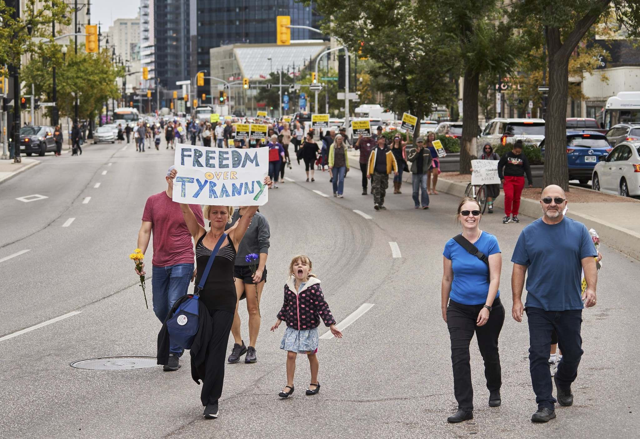 Protesters marched from the Manitoba Legislative Building to Winnipeg city hall on Sept. 13 after the rally was moved from HSC. (David Lipnowski / The Canadian Press files)