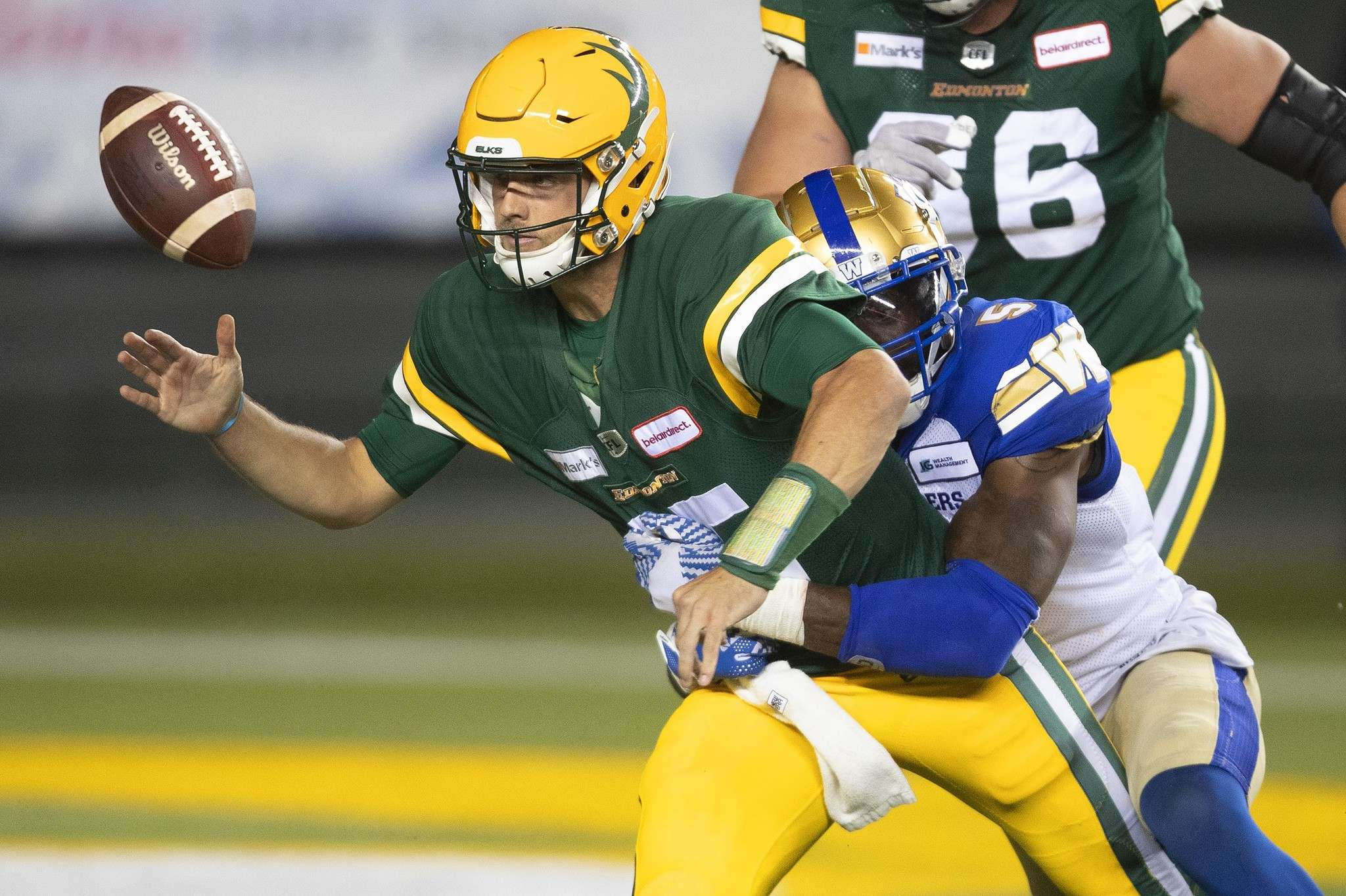 Blue Bombers' Willie Jefferson knocks the ball loose from Elks quarterback Taylor Cornelius on Saturday. The Elks see Cornelius eventually taking over from starting Elks QB Trevor Harris. (Jason Franson / The Canadian Press files)</p>