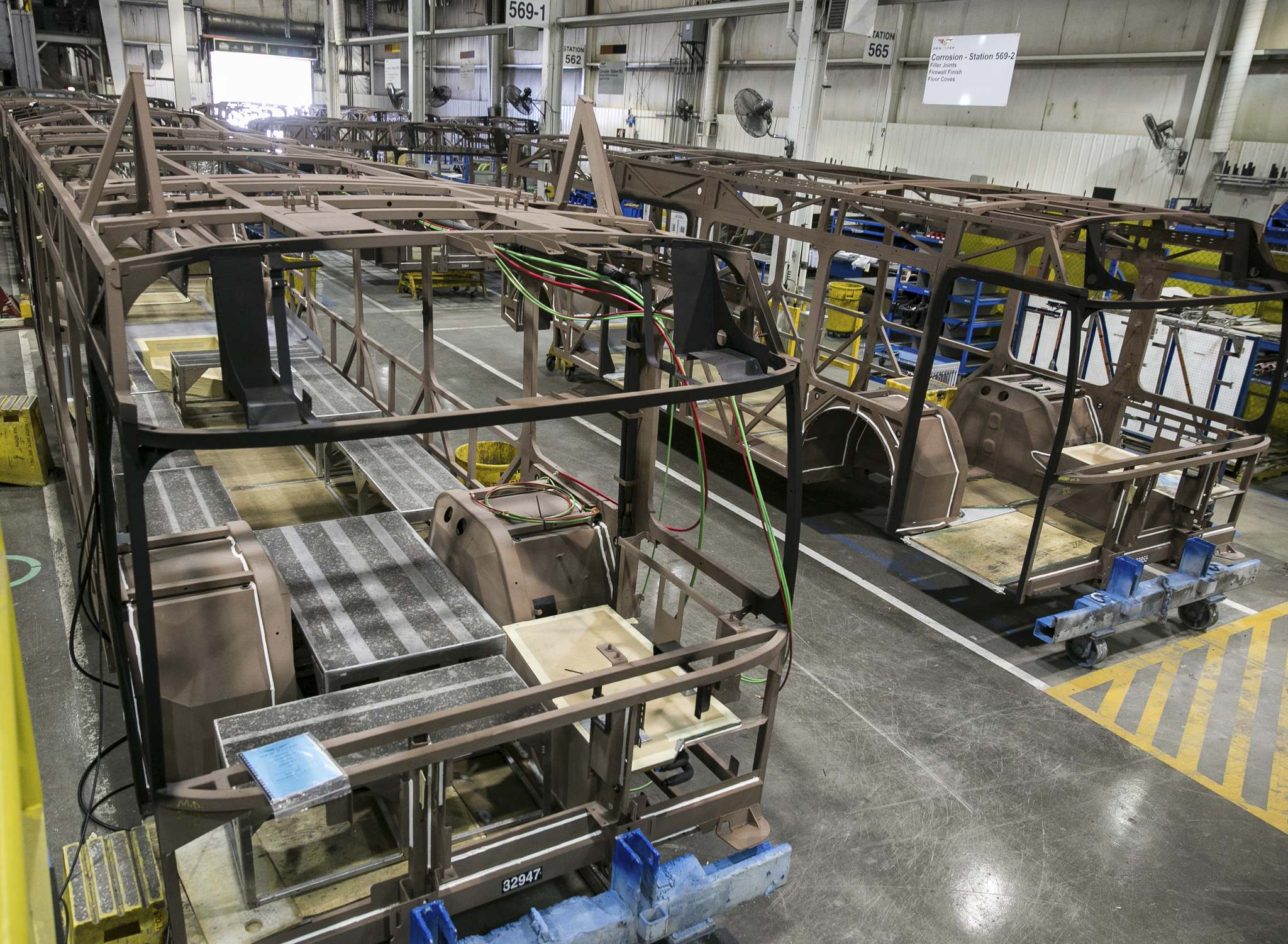 Melissa Tait / Winnipeg Free Press files</p><p>The manufacturing line at NFI. Rather than tie up cash starting production of vehicles it might not have the parts to complete, the bus maker decided to scale back production across the board.</p>