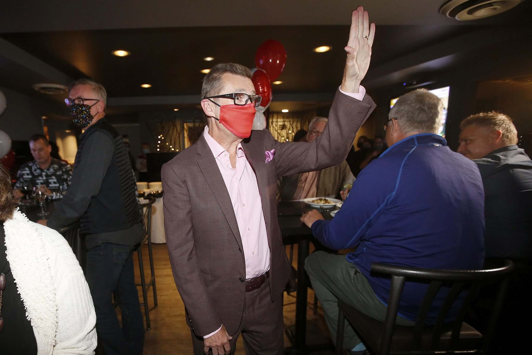 JOHN WOODS / WINNIPEG FREE PRESS</p><p>As the results rolled in Monday, Eyolfson dined with supporters at the Cork & Flame restaurant and bar.</p>