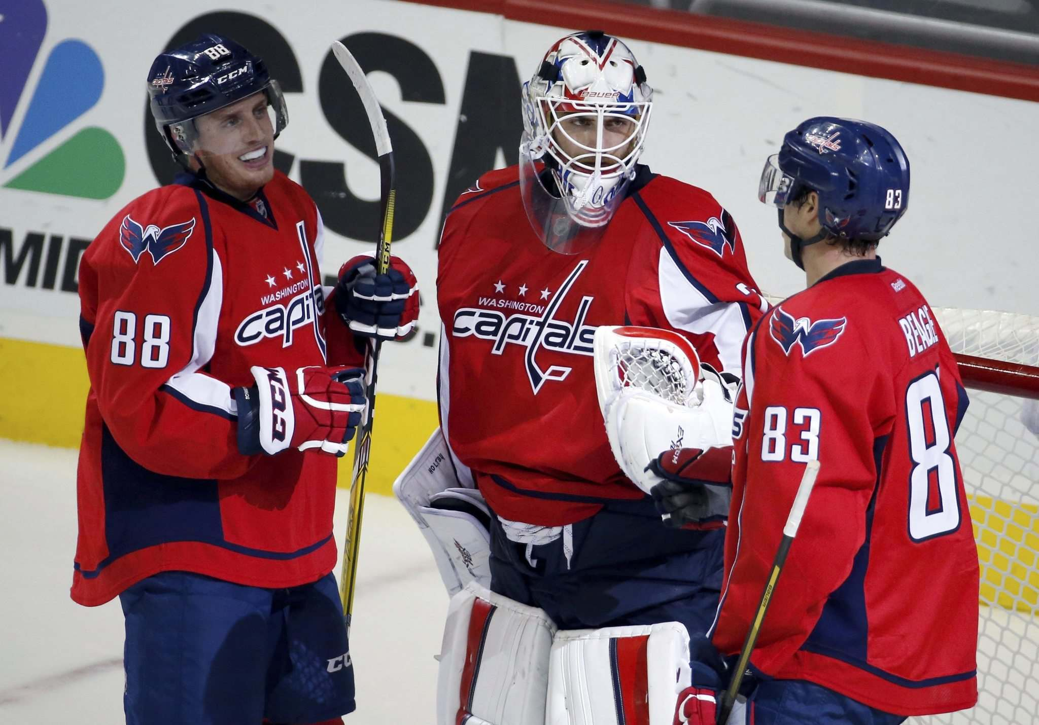Nate Schmidt (left), with former Washington Capitals teammates Braden Holtby (centre) and Jay Beagle, signed as an undrafted free agent after playing at the University of Minnesota. (Alex Brandon / The Associated Press files)