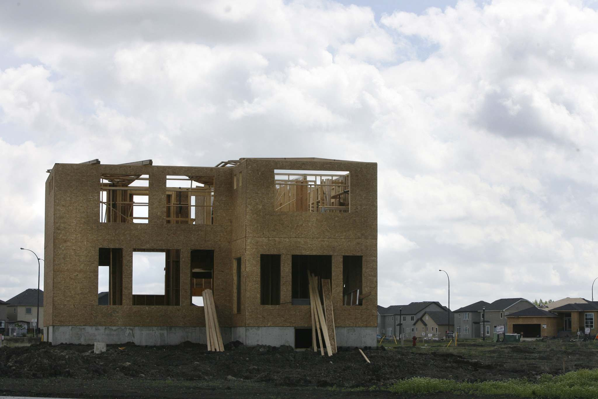 Pace of new home construction eased last month, CMHC says