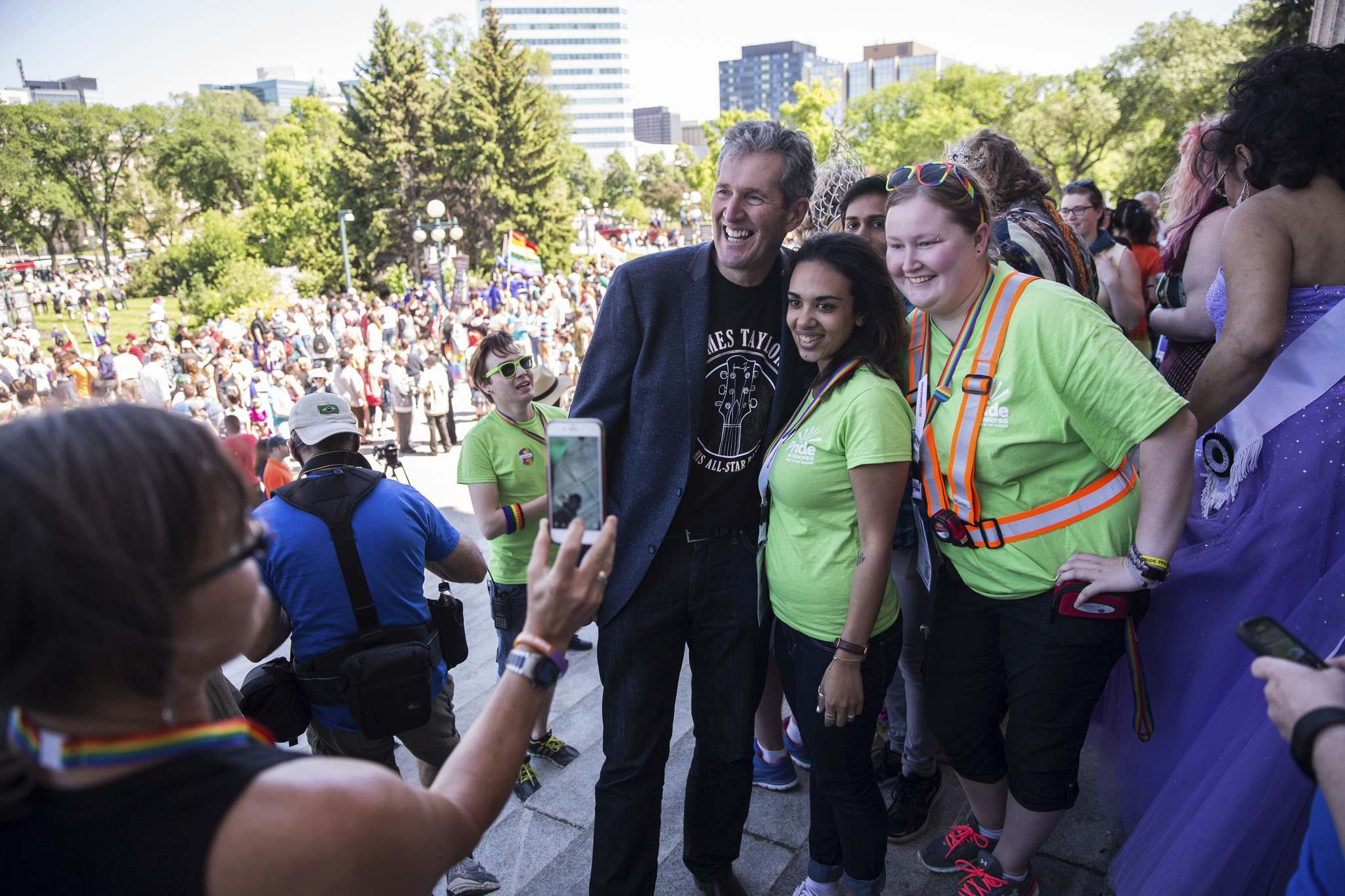 MIKE DEAL / WINNIPEG FREE PRESS FILES</p><p>Premier Brian Pallister gets his photo taken with Mona Mousa (centre) and Amanda Pratt (right) on the steps of the Manitoba Legislative Building before the start of Winnipeg's Pride parade in June.</p>