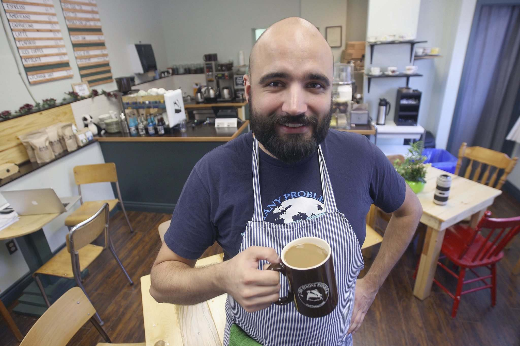 JOE BRYKSA / WINNIPEG FREE PRESS</p><p>Brock Peters, owner of the Strong Badger Coffeehouse at 679 Sargent Ave., searched the city before settling his new business in the young, diverse, walkable West End neighbourhood.</p></p>