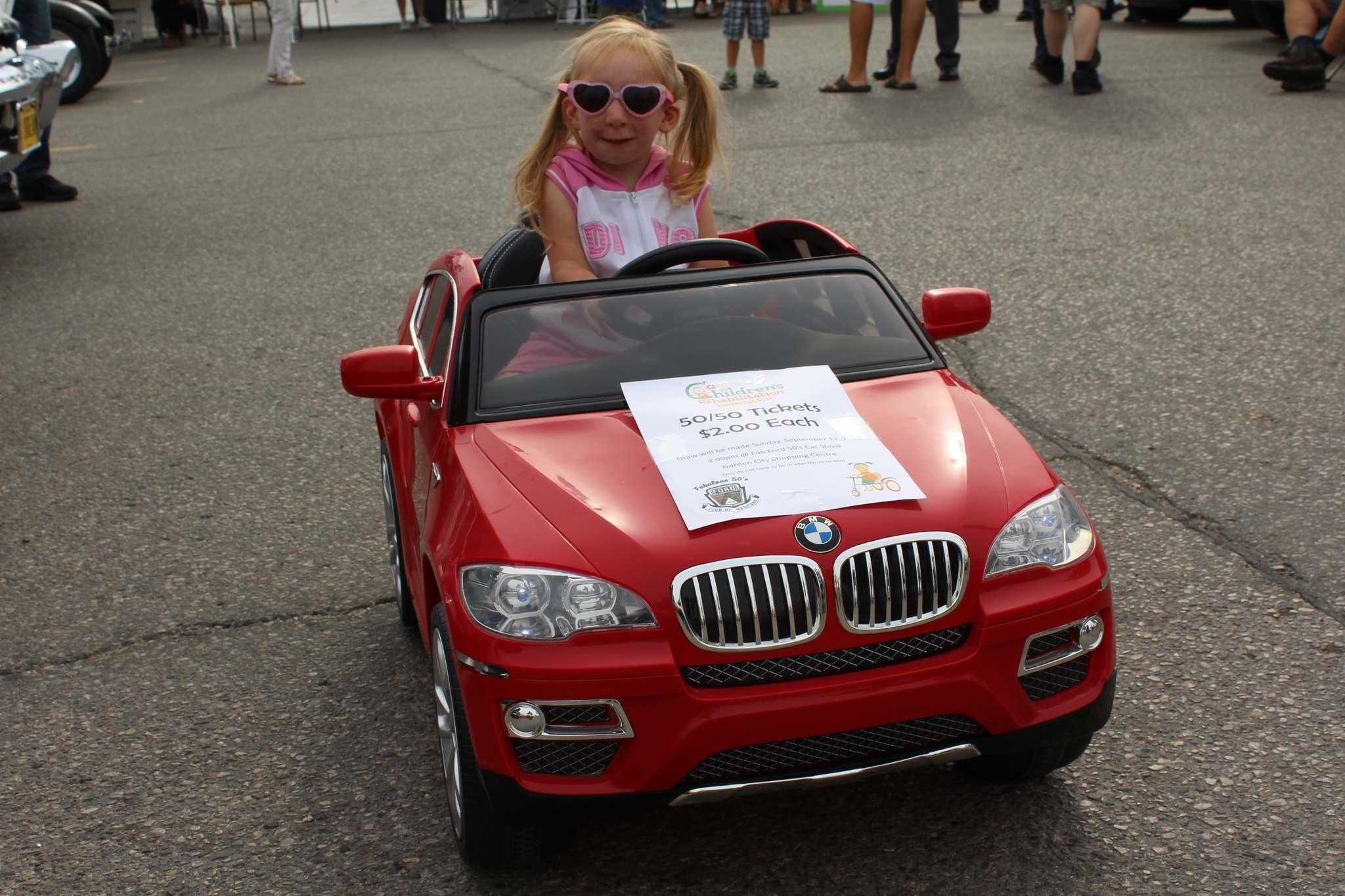 Children's Rehabilitation Foundation 2016 Child of the Year Willow Dueck enjoyed showing off her BMW convertible.