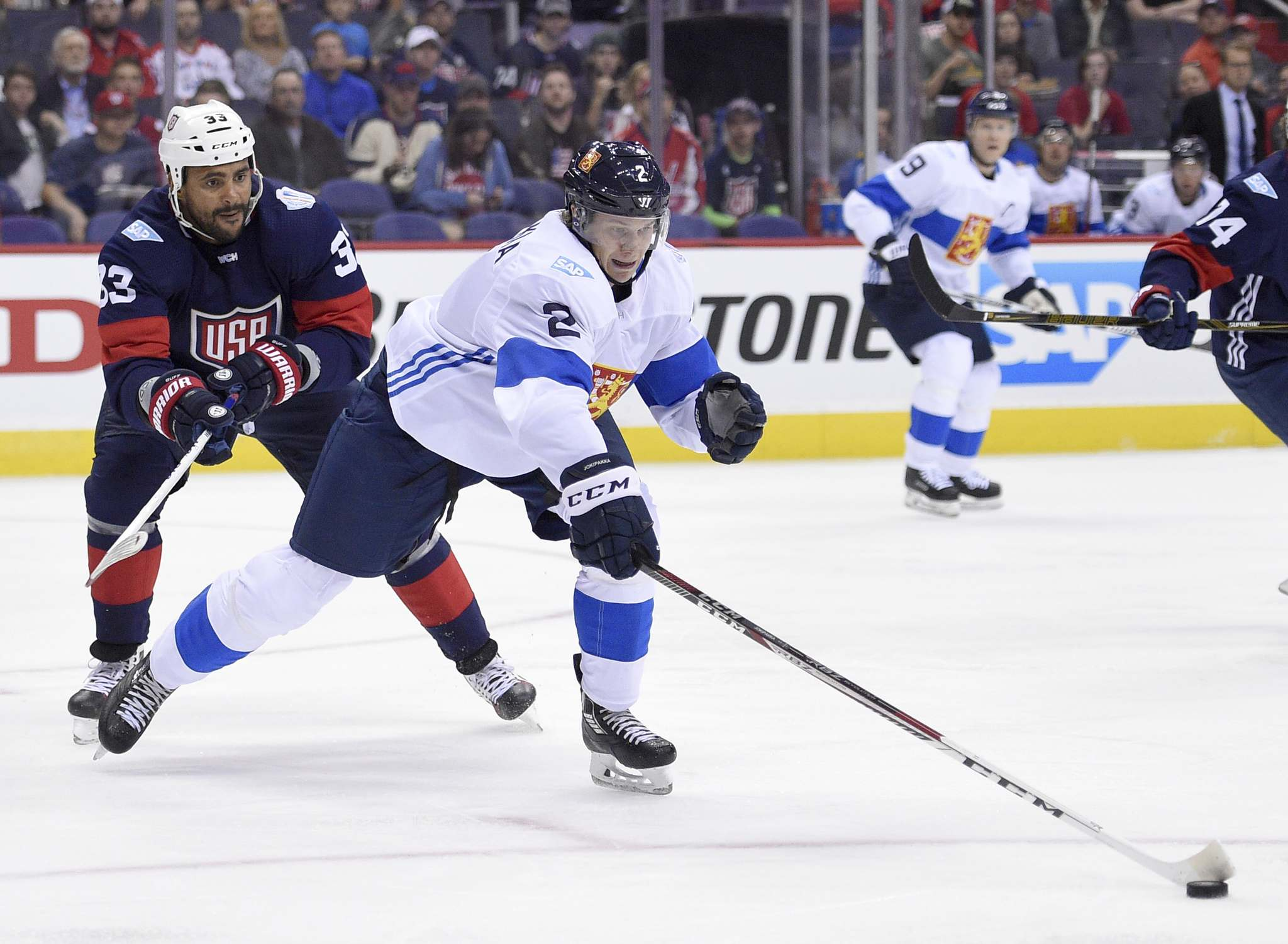 Nick Wass / The Associated Press</p><p>Finland defenseman Jyrki Jokipakka (2) reaches for the puck next to U.S. defenseman Dustin Byfuglien (33) during the first period of an exhibition game, part of the World Cup of Hockey, Tuesday, Sept. 13, 2016, in Washington.</p>