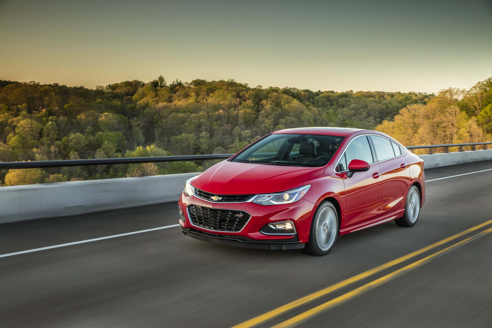 Handout / ChevroletThe newly redesigned Chevrolet Cruze eschews four-door plainness for a similar swoopy, coupe-like profile to the Honda Civic, and this isn't a bad thing
