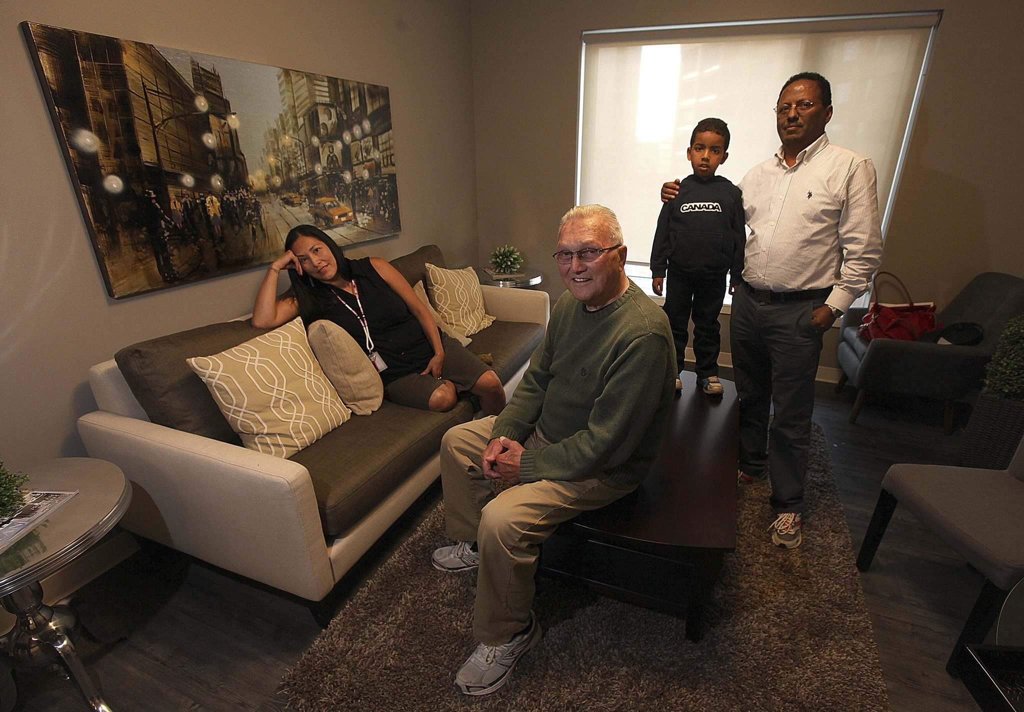 PHIL HOSSACK / WINNIPEG FREE PRESS</p><p>Angela Lavallee (from left), Eldon Toews, five-year-old Ewun Kidane and his father, Airia Kidane, are a few of the diverse tenants of the Downtown Commons.</p></p>