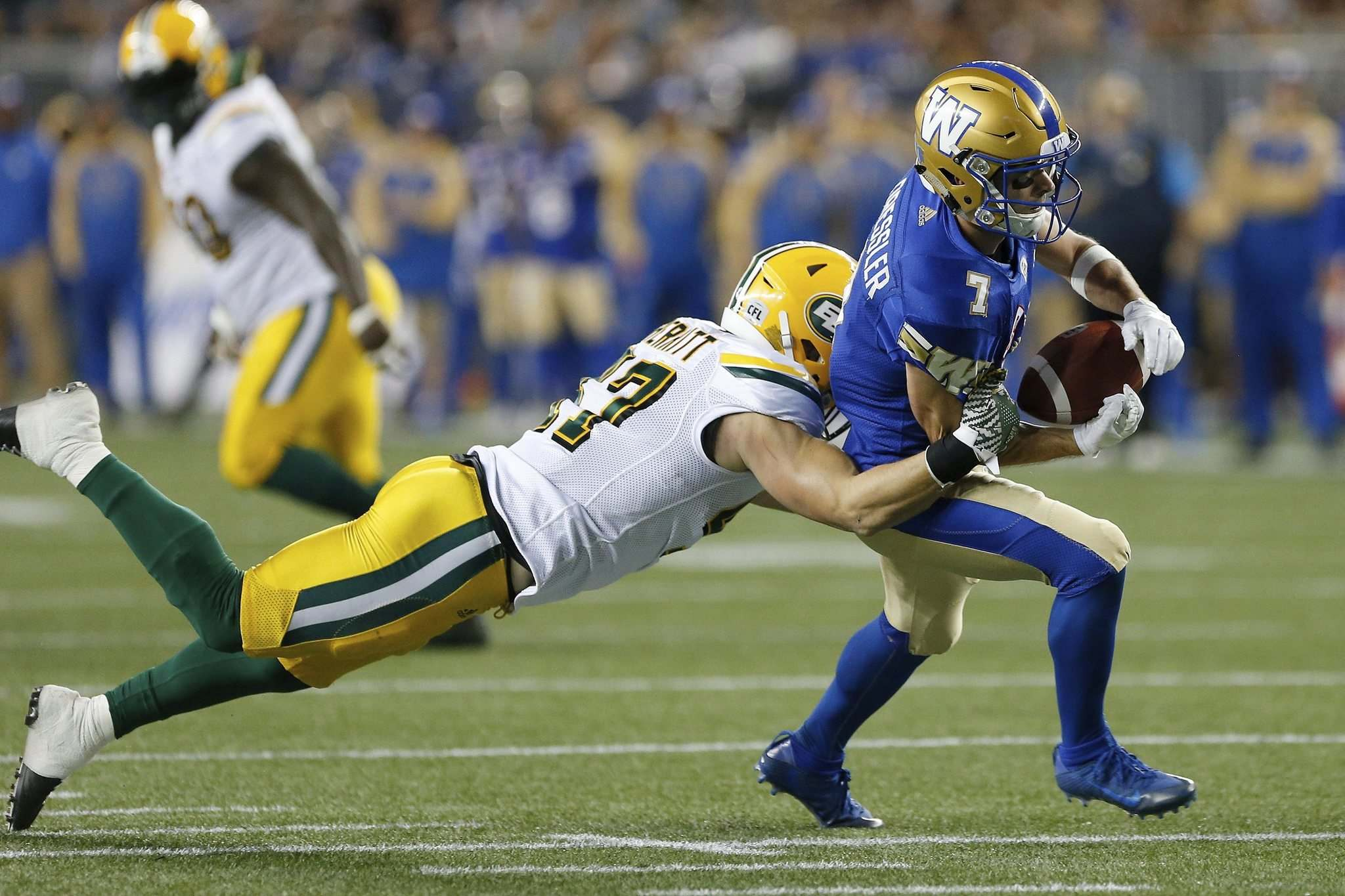 John Woods / The Canadian Press</p><p>Edmonton Eskimos' JC Sherritt strips the ball from the hands of Winnipeg Blue Bombers' Weston Dressler during the first half of CFL action in Winnipeg Friday.</p>