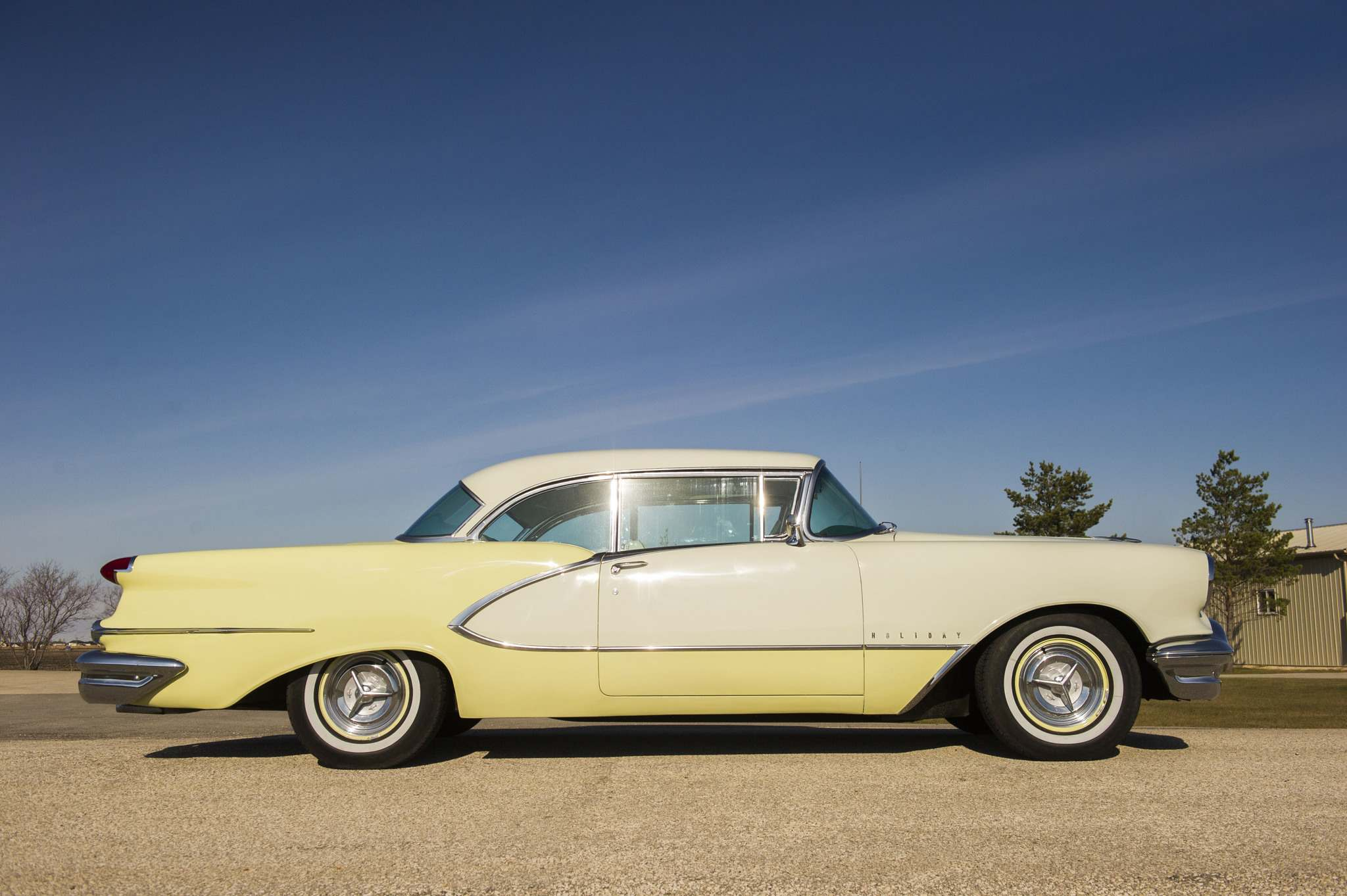 This 1956 Oldsmobile 98 two-door hardtop still has its original, two-tone paint colours of Citron Cream and Antique White.