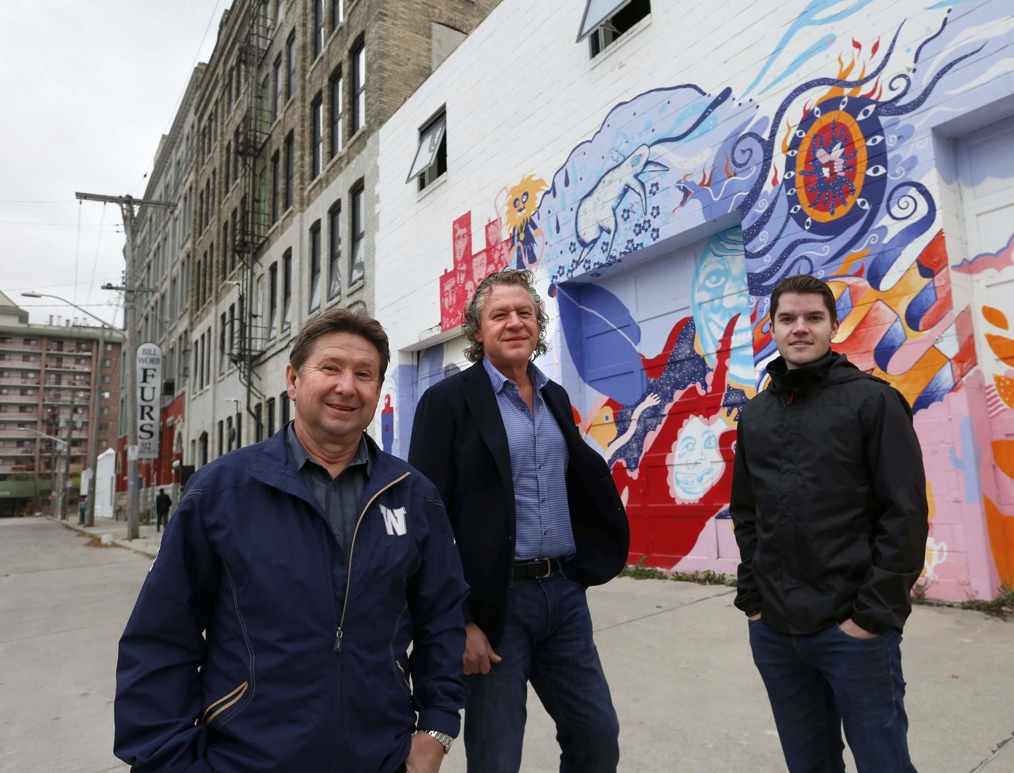 WAYNE GLOWACKI / WINNIPEG FREE PRESS</p><p>Developers Rick (from left) and Mark Hofer and Bryce Alston are investing $12 million in the redevelopment and construction of numerous properties on Ross Avenue, west of Princess Street.</p>