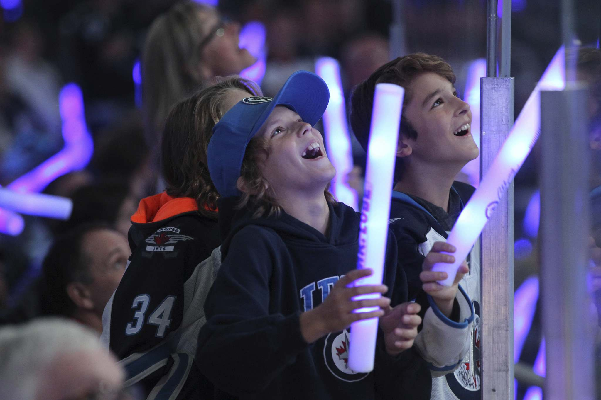 RUTH BONNEVILLE / WINNIPEG FREE PRESS</p><p>Young Jets fans Stefan bang tap on the glass with their baton's as they celebrate the start of The Winnipeg Jets play home opener game against the Carolina Hurricanes' at MTS Centre.</p>