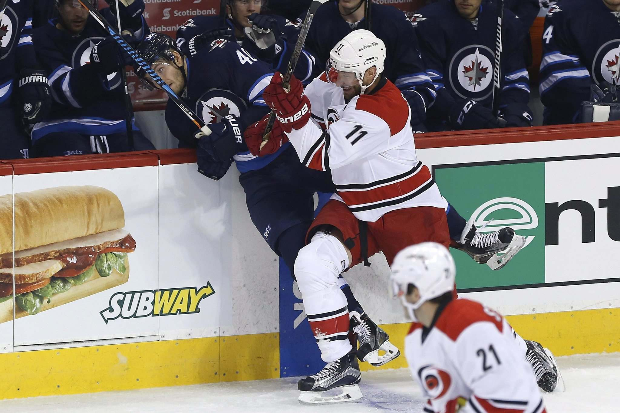 John Woods / The Canadian Press</p><p>Carolina Hurricanes' Jordan Staal (11) checks Winnipeg Jets' Joel Armia (40) into the boards as Hurricanes' Lee Stempniak (21) looks on during first period NHL action in Winnipeg on Thursday.</p>
