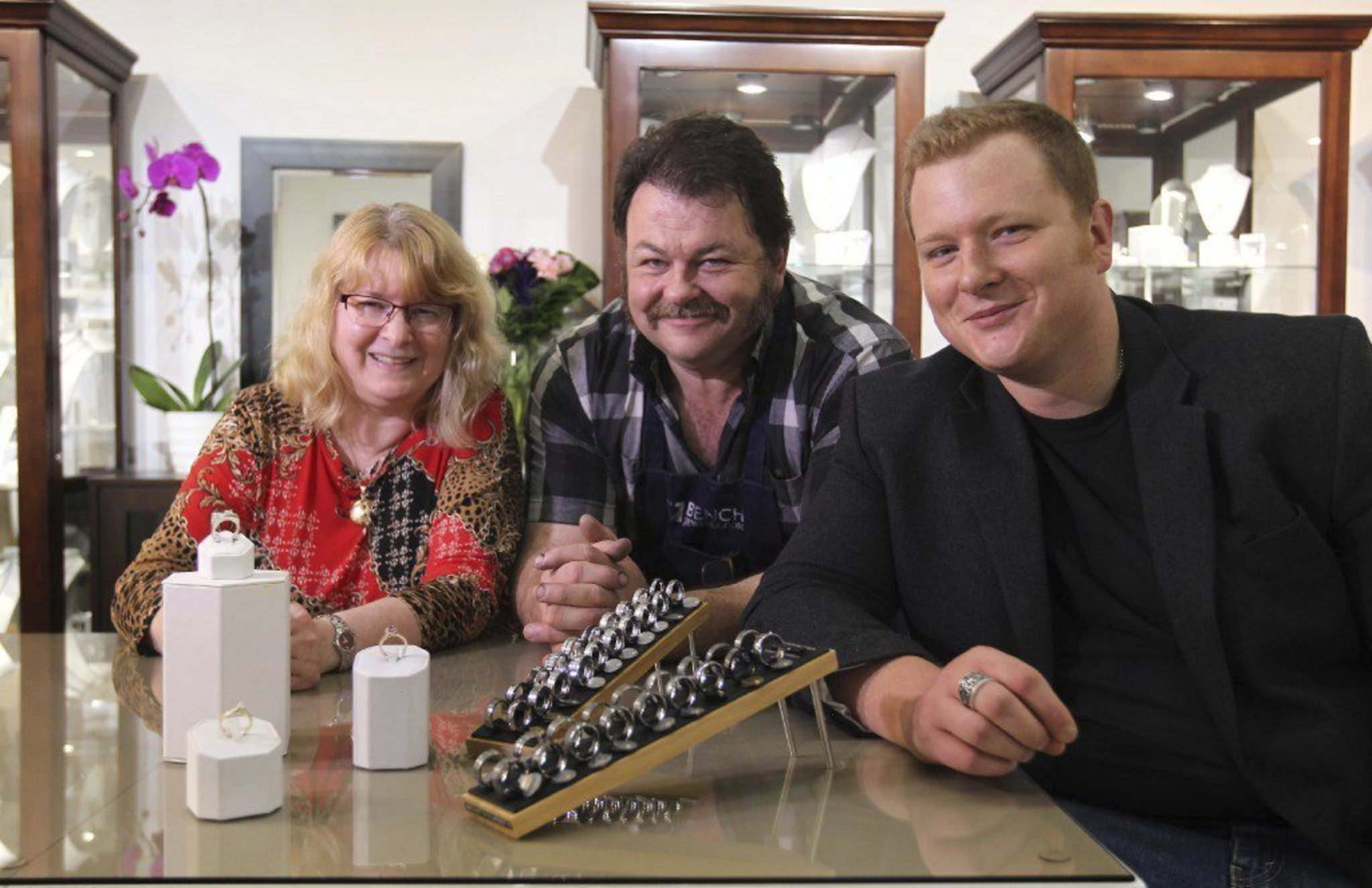 Tom (centre) and Peggy Sutton with Tom&rsquo;s son James Sutton at Sutton Smithworks, a 23-year-old jewelry shop that has been investing in a lot of new technology.</p></p>