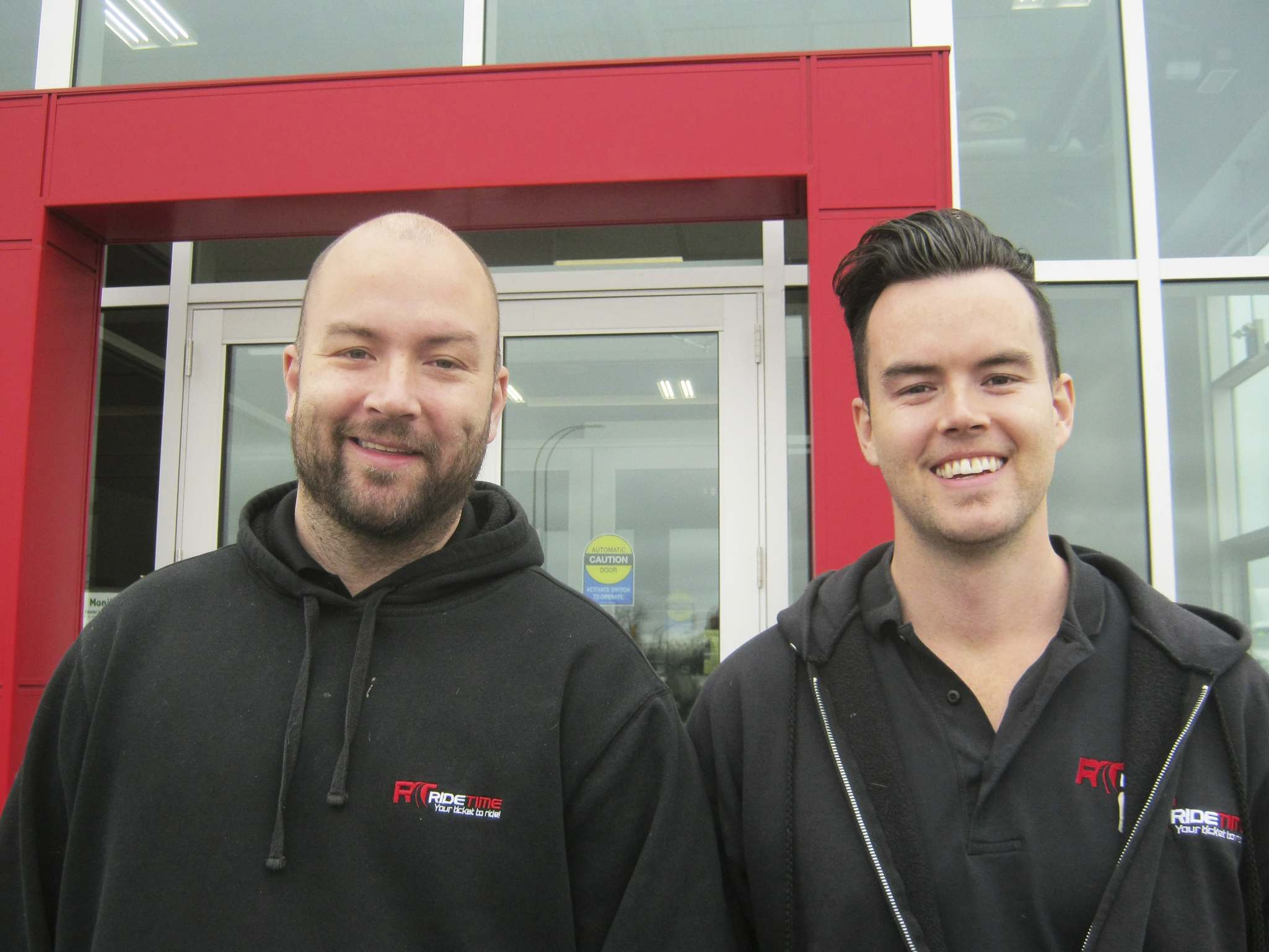 Doug, left, and Andrew MacIver stand outside their new location of their used car enterprise Ride Time on Oak Point Highway. The location, promoted in an advertisement last spring, has opened for business.