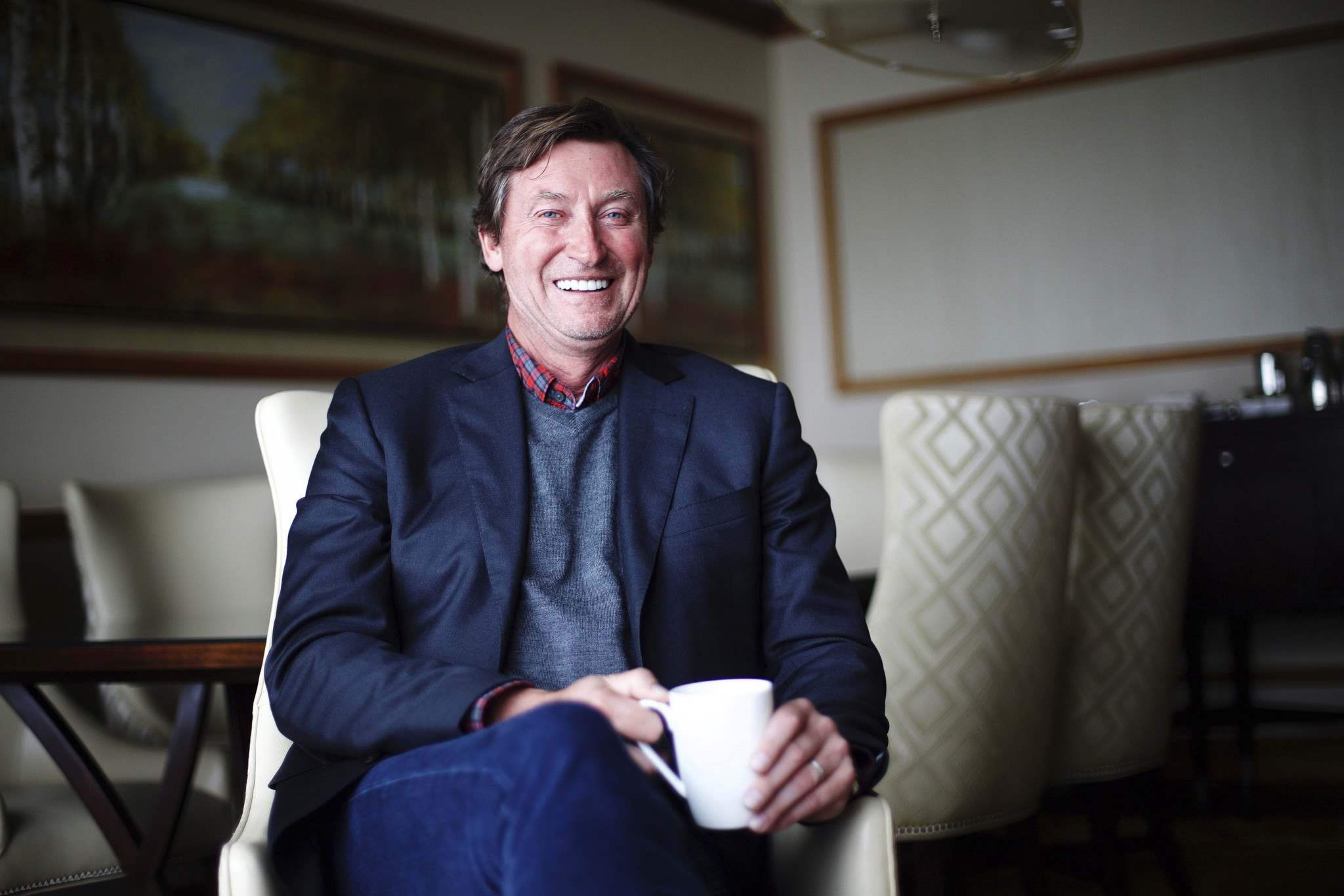 "MICHELLE SIU / THE CANADIAN PRESS</p><p>Hockey legend Wayne Gretzky poses for a photo to promote his new book ""99: Stories of the Game"" in Toronto on Monday, October 17, 2016.</p>"