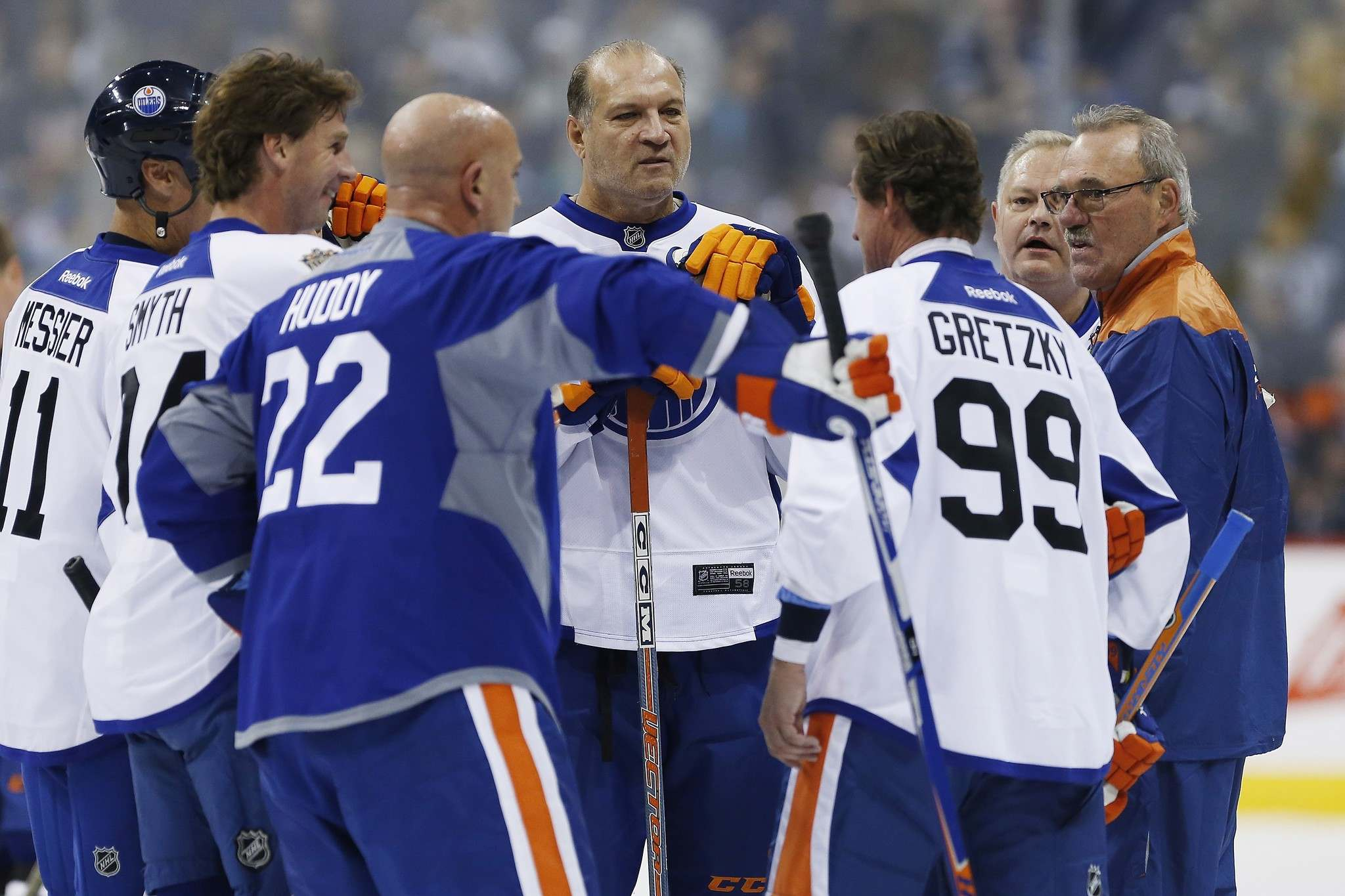 John Woods / The Canadian Press</p><p>Former Edmonton Oilers Dave Semenko, centre, and others listen in as captain Wayne Gretzky (99) leads a huddle during a practice for the NHL's Heritage Classic Alumni game in Winnipeg on Friday.</p>