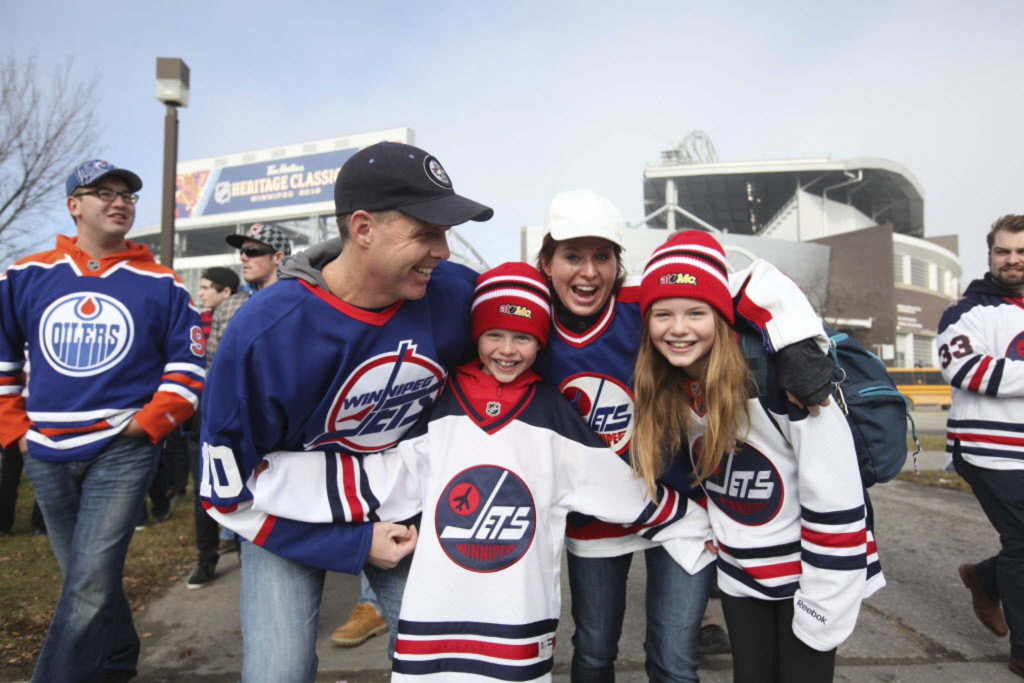 RUTH BONNEVILLE / WINNIPEG FREE PRESS</p><p>The MacInness family - Doug, Shannon, son Ben and daughter Abby - show off their excitement outside the stadium prior to the start of the alumni game Saturday. </p>