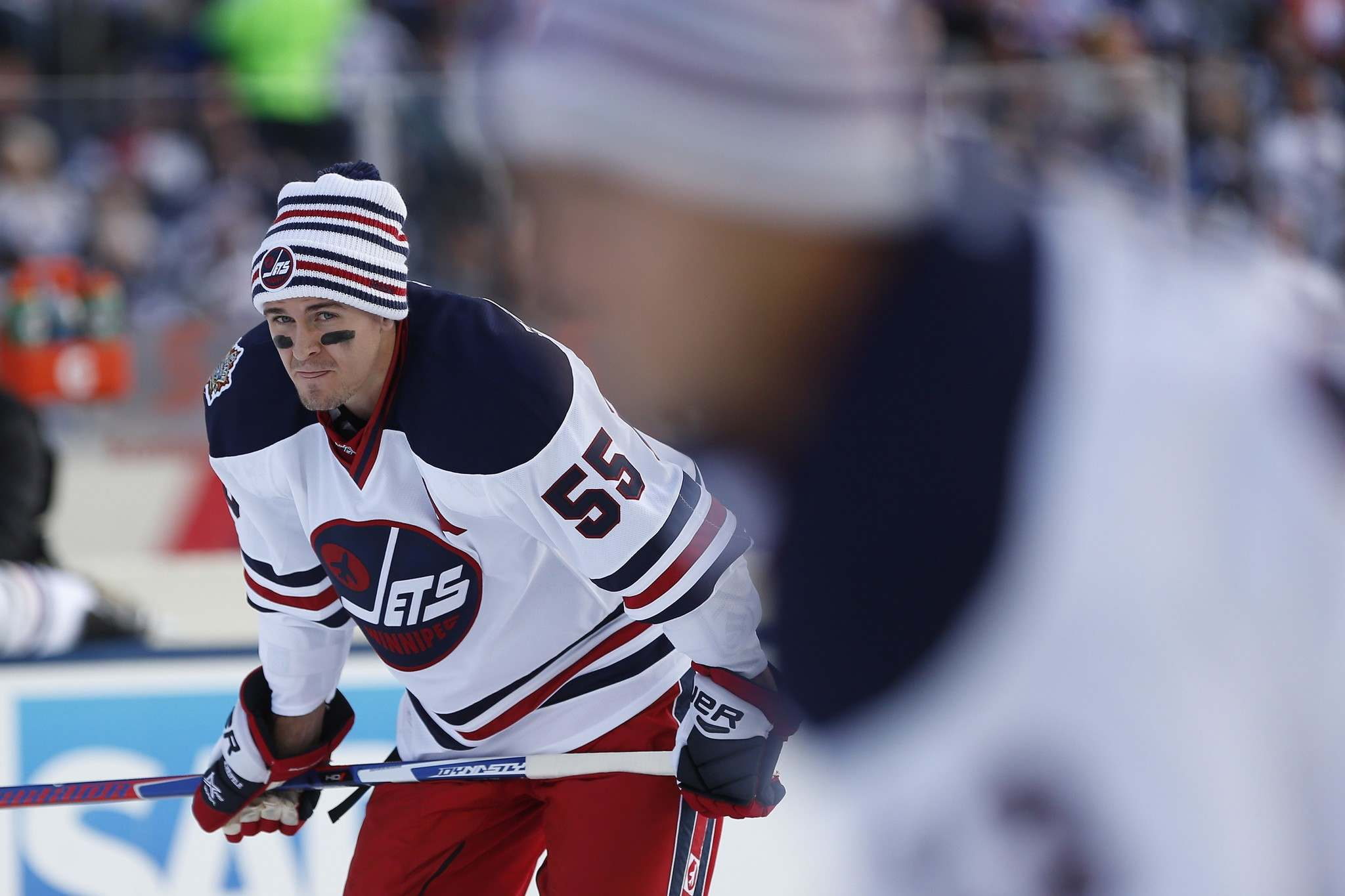 John Woods / The Canadian Press</p><p>Winnipeg Jets' Mark Scheifele (55) looks on as Patrik Laine (29) takes a shot during the warmup skate at the NHL Heritage Classic in Winnipeg on Sunday.</p>