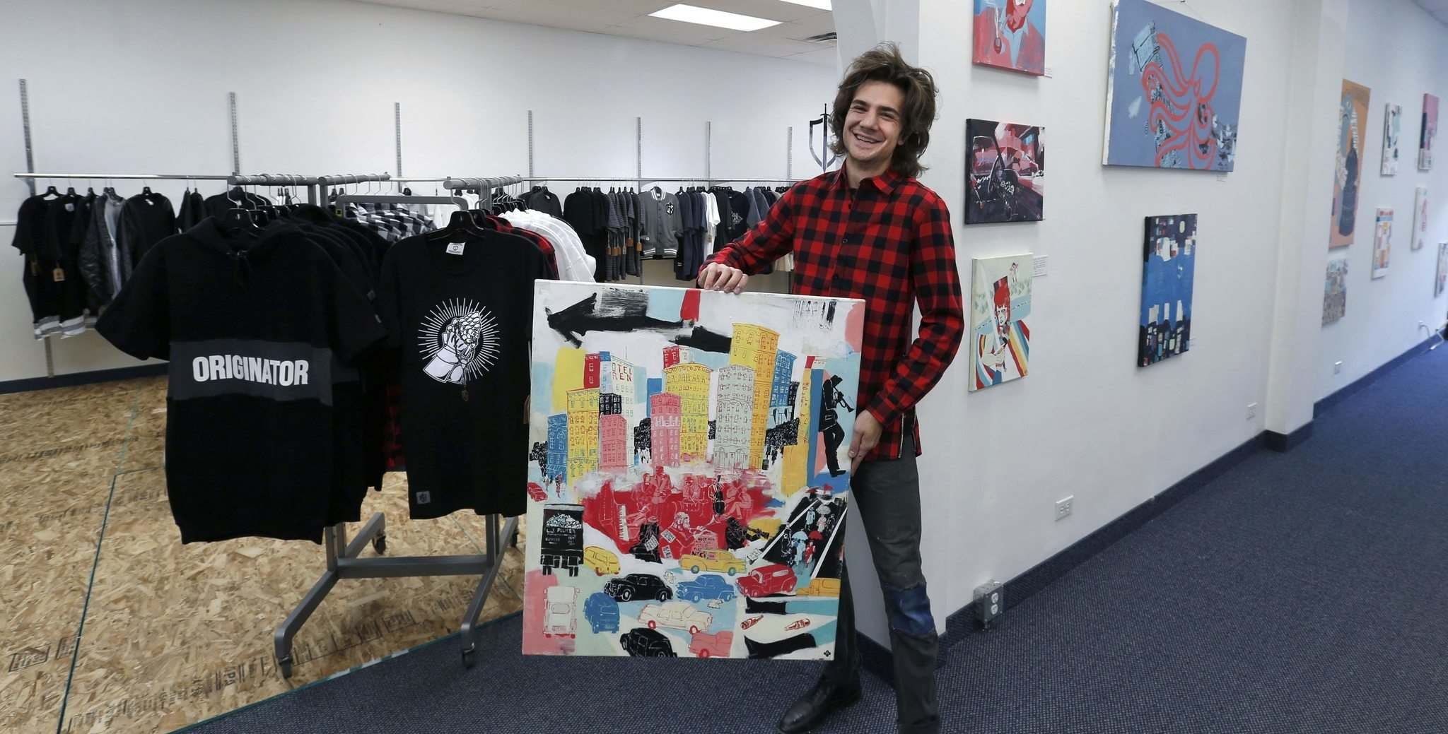 WAYNE GLOWACKI / WINNIPEG FREE PRESS</p><p>Artist Josiah Koppanyi owner of Josiah Galleries with his paintings shares the space with Eric Olek's Friday Knights Clothing & Accessories at left.</p>