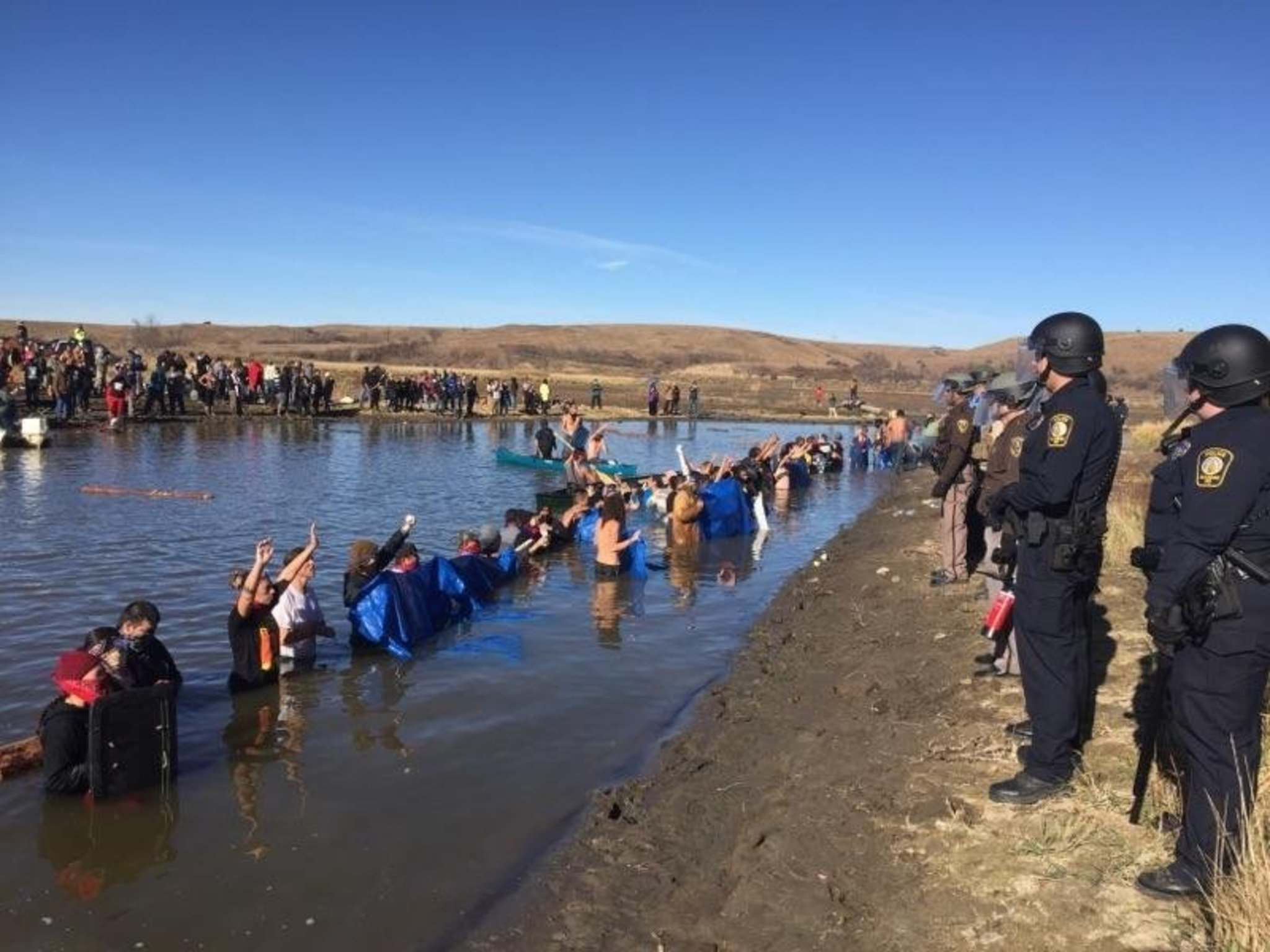 MORTON COUNTY SHERIFF'S OFFICE / TNS</p><p>Police face tribal members from across the country and their supporters protesting against the Dakota Access Pipeline in Standing Rock, N.D. </p>