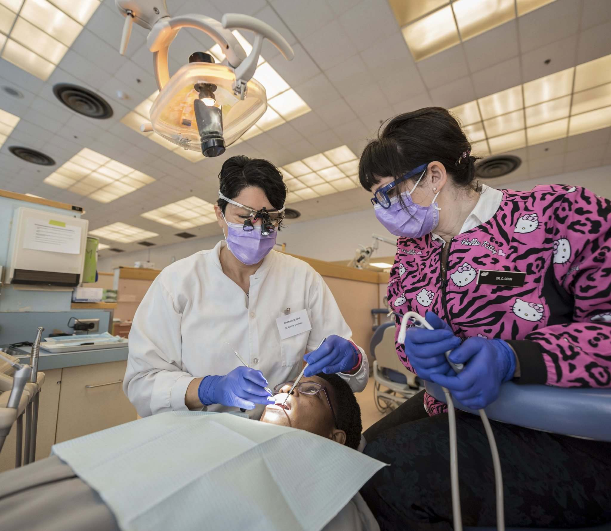 Newcomers all smiles after free volunteer dental clinic - Winnipeg