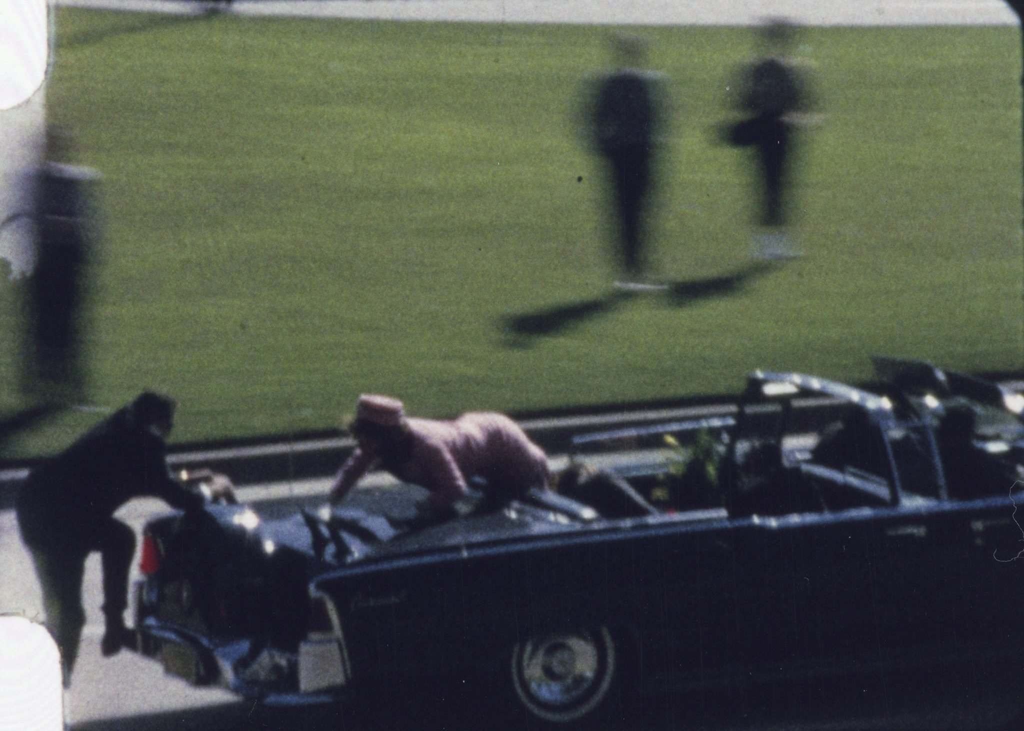 Zapruder Film &#169;, The Sixth Floor Museum at Dealey Plaza</p><p>In a still from Abraham Zapruder&rsquo;s 8mm film, Secret Service agent Clint Hill (left) and Jacqueline Kennedy are seen scrambling after then-president John F. Kennedy was shot.</p>
