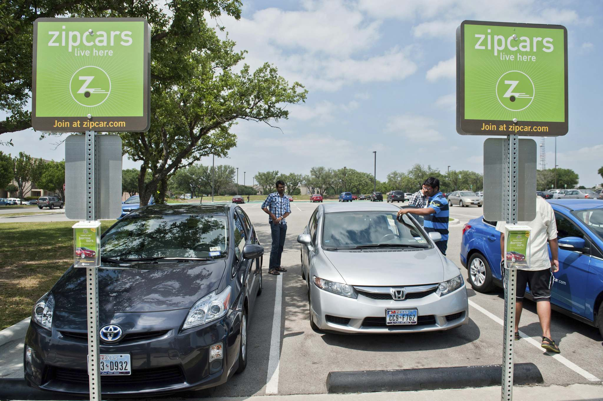 Steve Pfost / Dallas Morning NewsStudents trade out a Honda Civic zip car from the UT Dallas campus in Richardson, Texas.