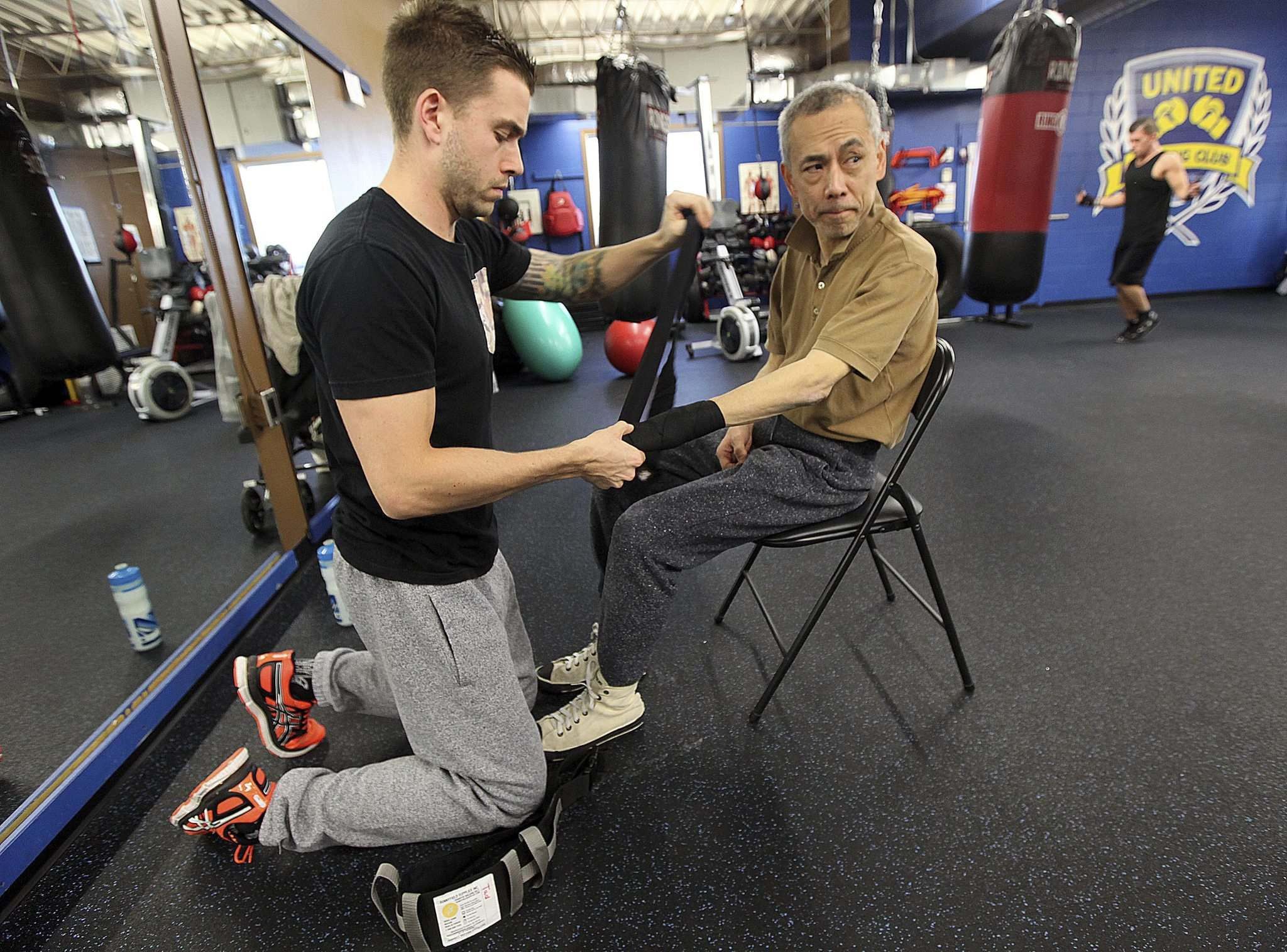 PHIL HOSSACK / WINNIPEG FREE PRESS</p><p>Trainer Braden Pyper (left) tapes Tadashi Orui prepping for his workout.</p></p>