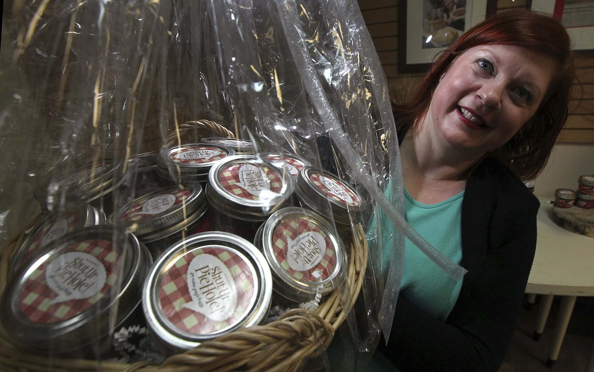 PHIL HOSSACK / WINNIPEG FREE PRESS</p><p>Shut Ur Pie Hole owner Heather Daymond shows off a gift basket packed with jars of pie.</p>