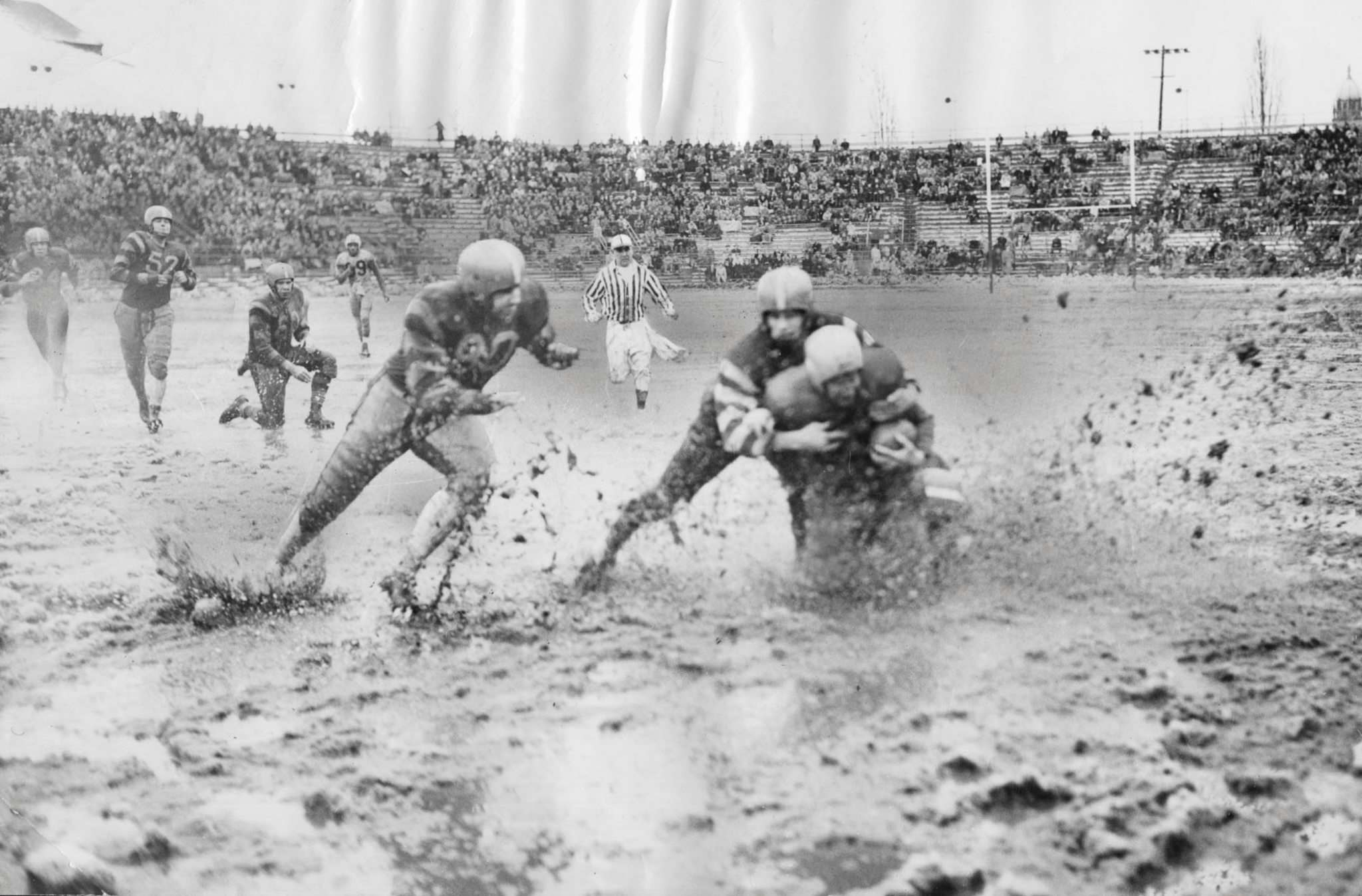CP PHOTO/Toronto Star</p><p>Action from the 1950 Grey Cup game in Toronto, also known as the &#34;Mud Bowl.&#34;</p>