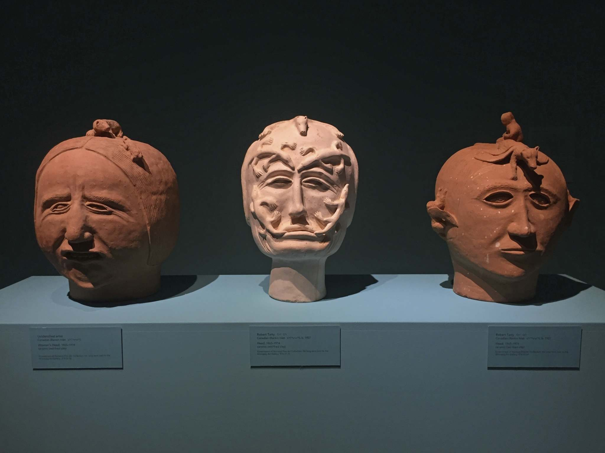 Stone heads (centre and right) by Robert Tatty in the Our Land exhibit.</p>