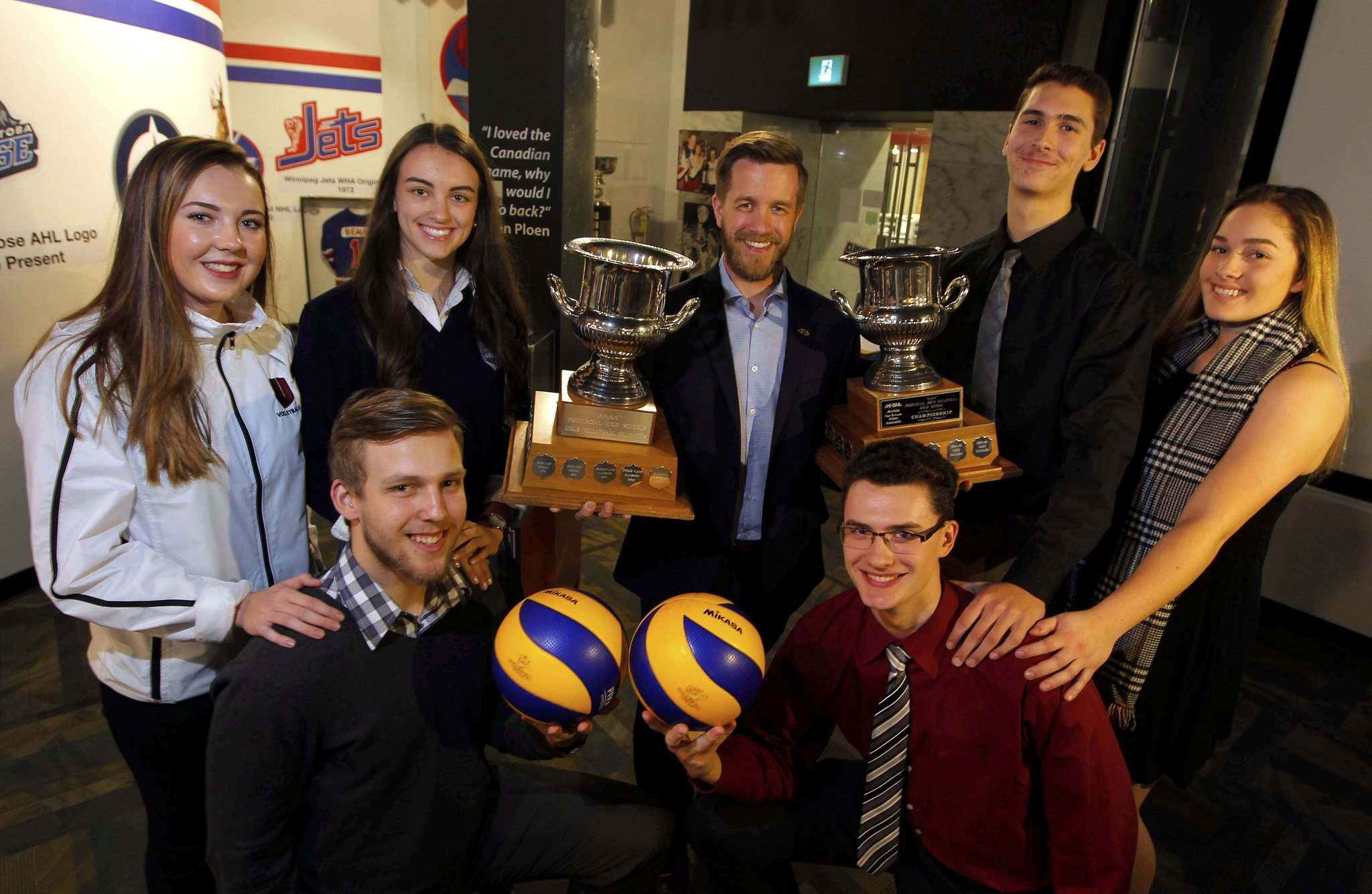 BORIS MINKEVICH / WINNIPEG FREE PRESS</p><p>Representatives for many of the teams participating in the AAAA High School Volleyball Championships 'final fours' pose with the trophies. In the back, from left to right: Kelli Beatty (Westwood), Jenna Cross (St. Mary's), Chad falk and Owen Schwartz (Selkirk), Maegan Balagus (Selkirk). In front: Ryan Arcand (Dakota) and Justice Lesuk (Miles Mac).</p>