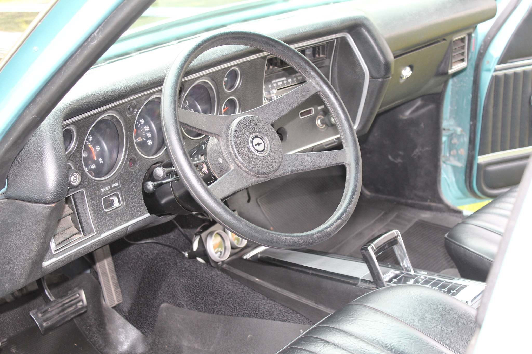 Upgrades to the car's interior include new vinyl door panels, carpet and oil and temperature gauges.