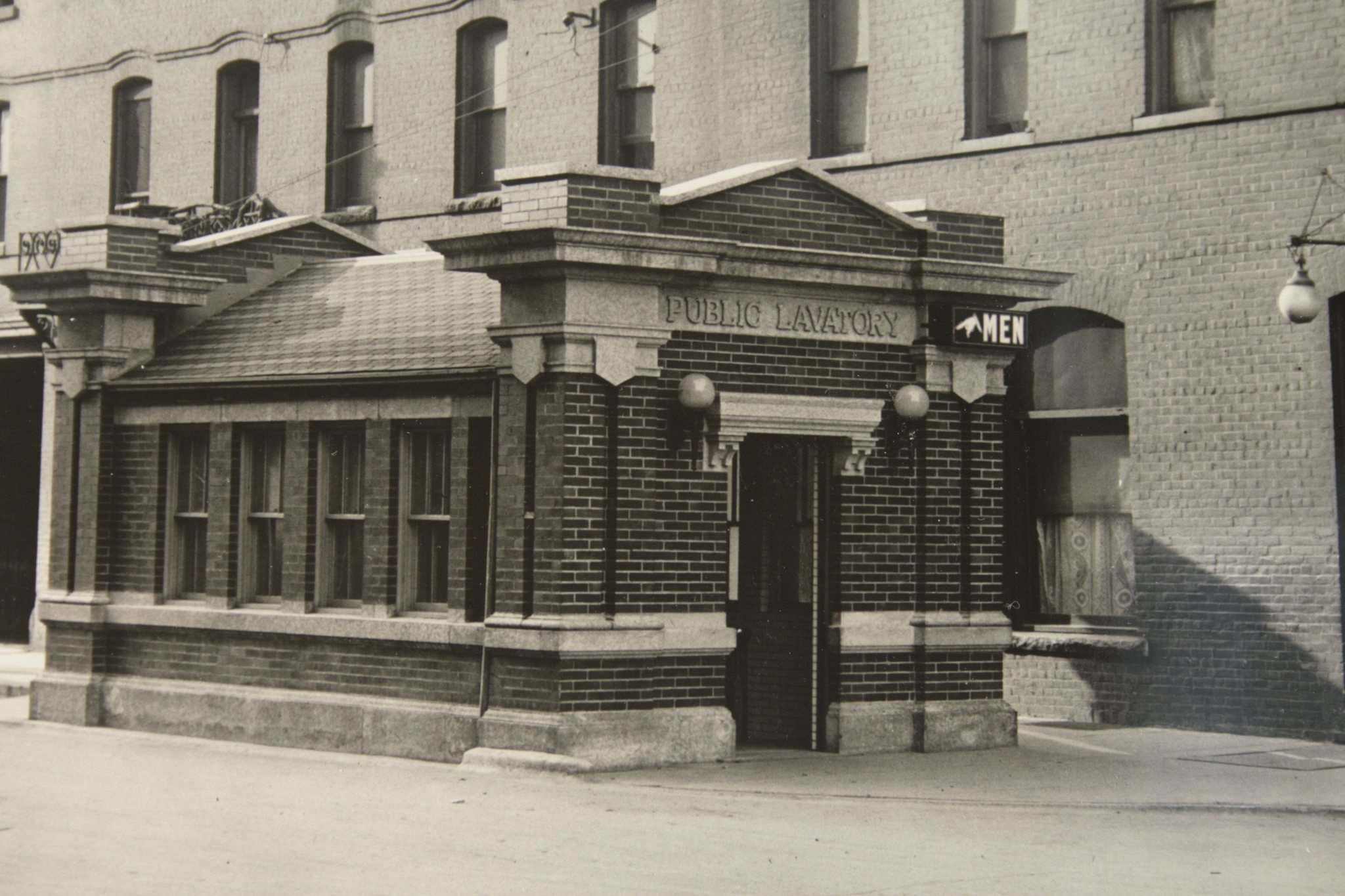 ARCHIVES OF MANITOBA</p><p>The Logan Street comfort station circa 1918. The Occidental Hotel, now Red Road Lodge, is the building beside it.</p>