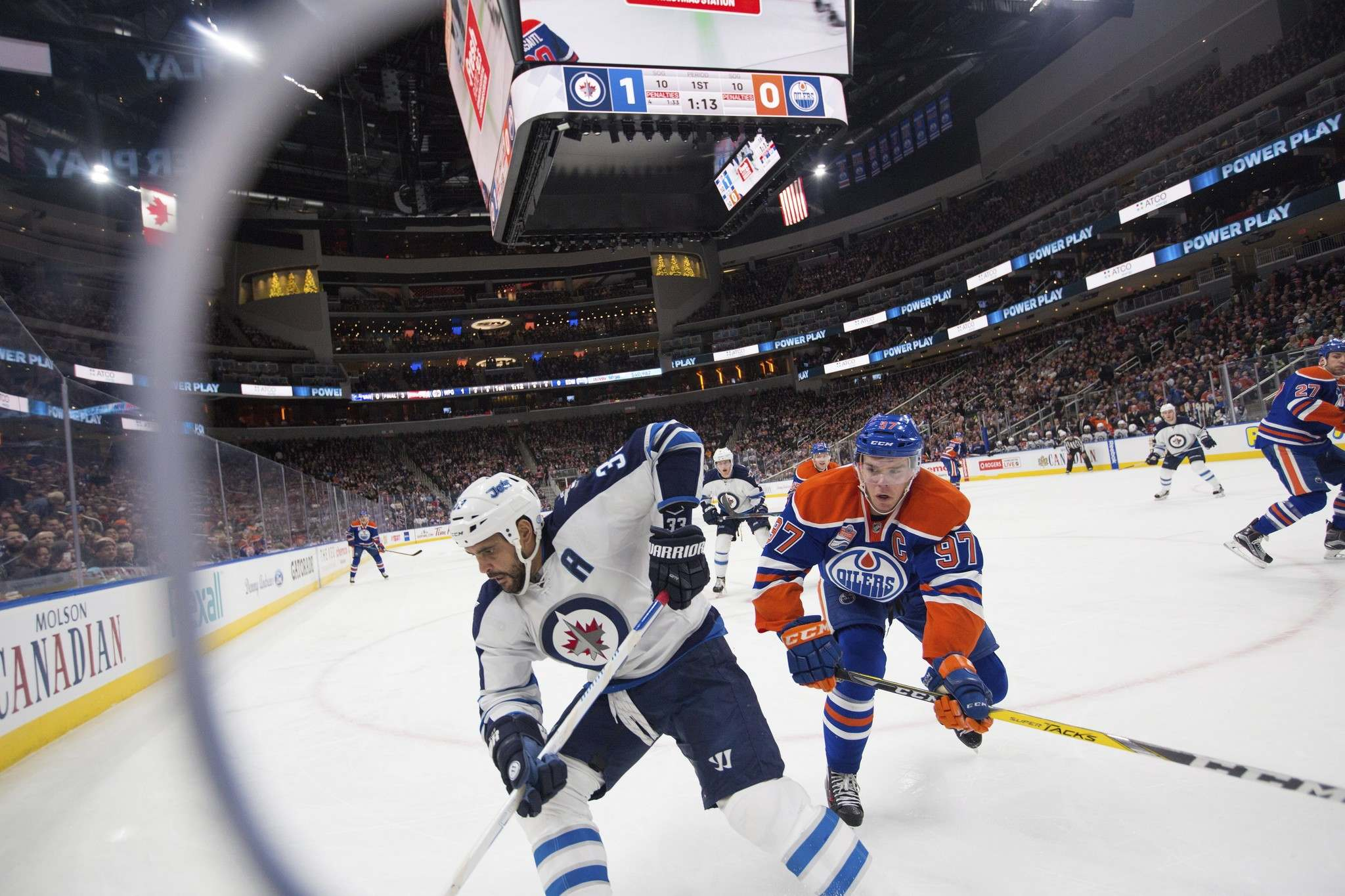 Amber Bracken / The Canadian Press</p><p>Winnipeg Jets' Dustin Byfuglien (33) keeps ahead of Edmonton Oilers' Connor McDavid (97) with the puck during first period NHL hockey action in Edmonton, Alta., on Sunday December 11, 2016.</p>