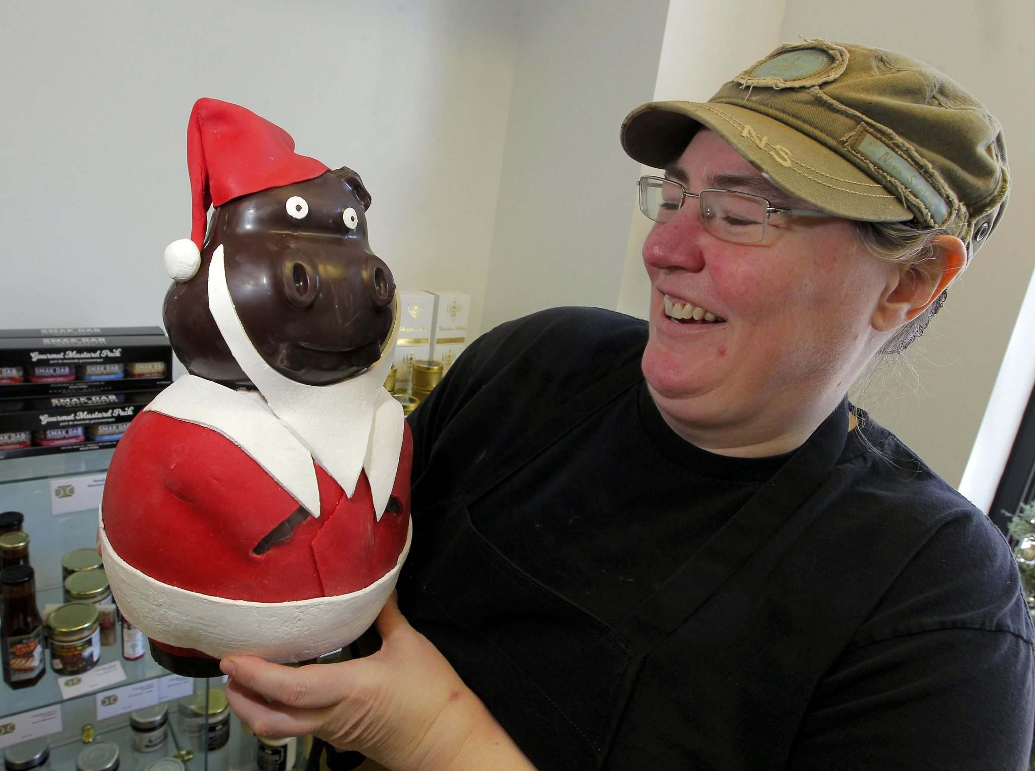 BORIS MINKEVICH / WINNIPEG FREE PRESS</p><p>SUNDAY THIS CITY - Decadence Chocolates on Sherbrook St. Owner Helen Staines poses with one of the Christmasy chocolate creations she makes for the holiday season. This is a over 2kg chocolate pig. DAVE SANDERSON STORY. Dec. 13, 2016</p></p>
