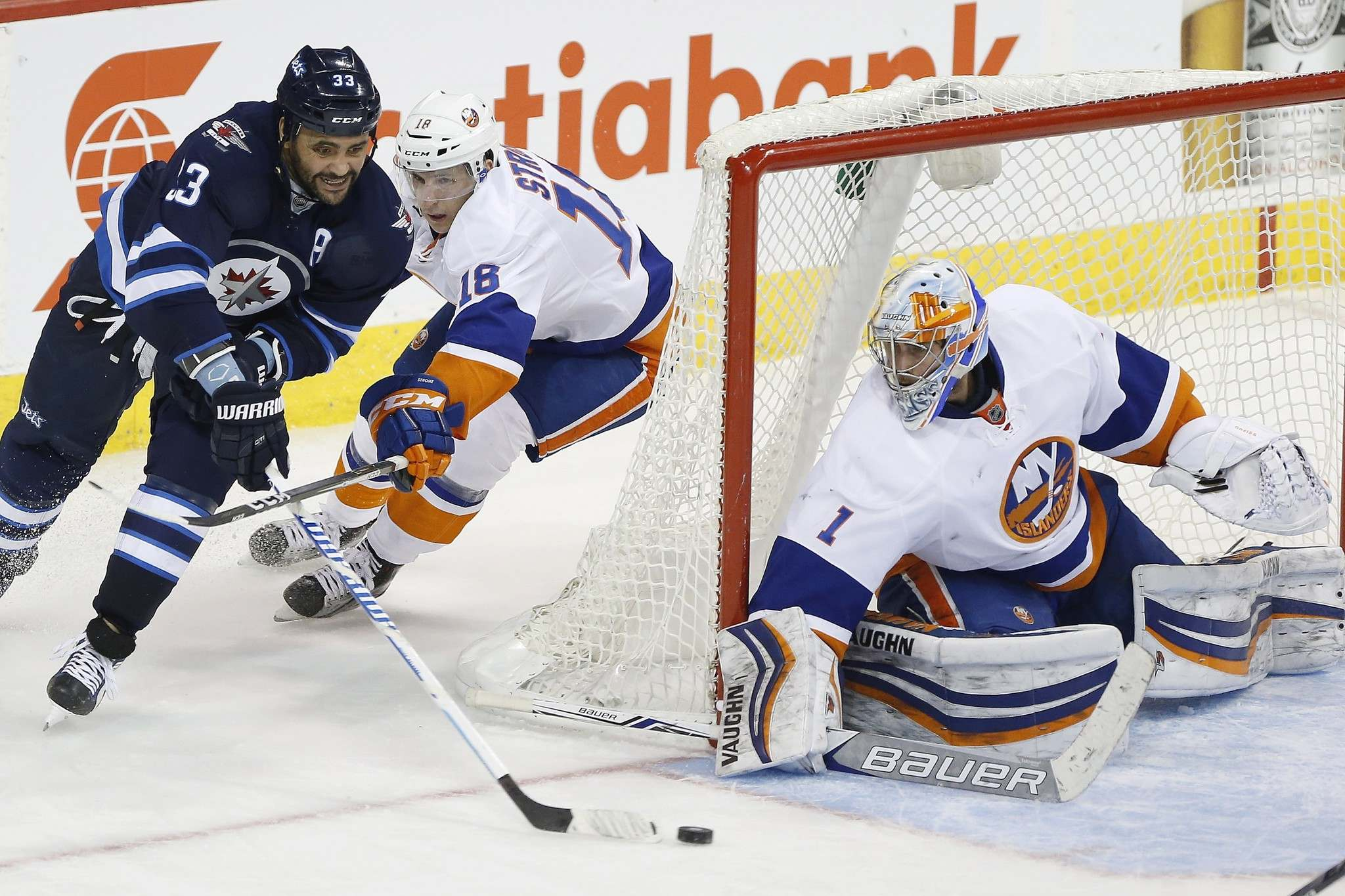 JOHN WOODS / THE CANADIAN PRESS</p><p>New York Islanders' Ryan Strome (18) chases Winnipeg Jets' Dustin Byfuglien (33) as he attempts the wraparound on New York Islanders goaltender Thomas Greiss (1) during the third period.</p>