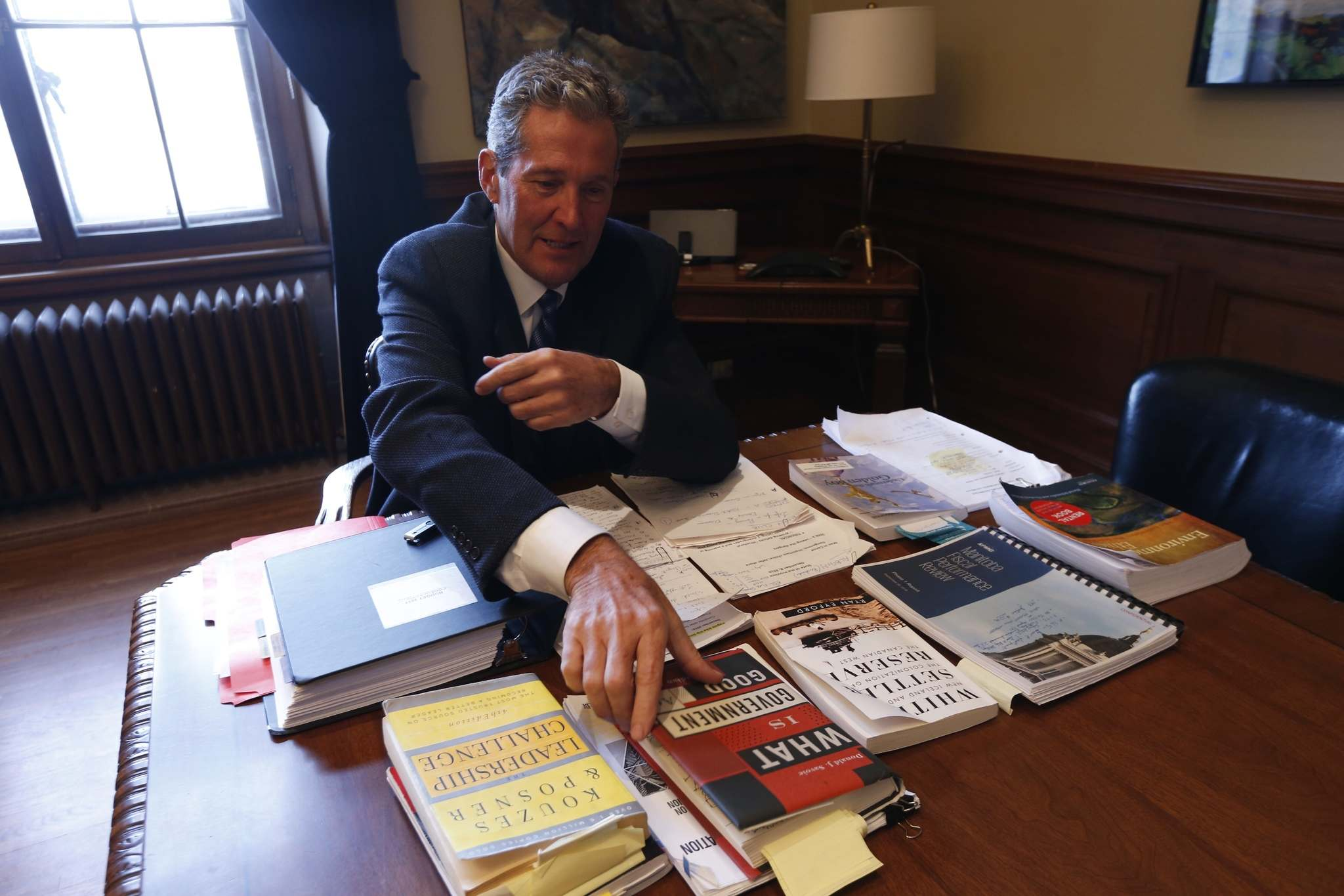 WAYNE GLOWACKI / WINNIPEG FREE PRESS</p><p>Premier Brian Pallister in his office Friday with a sample of the reading material he had with him in Costa Rica. </p>
