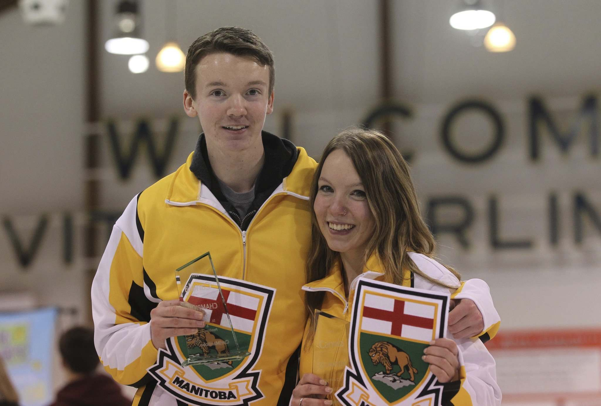 RUTH BONNEVILLE / WINNIPEG FREE PRESS</p><p>Assiniboine Memorial skip J.T. Ryan and his sister, Hailey, third on Laura Burtynk's Assiniboine Memorial Team, celebrate winning the 2017 Canola Junior Provincial Championships in the men's and women's categories at St. Vital Arena Friday afternoon.</p>