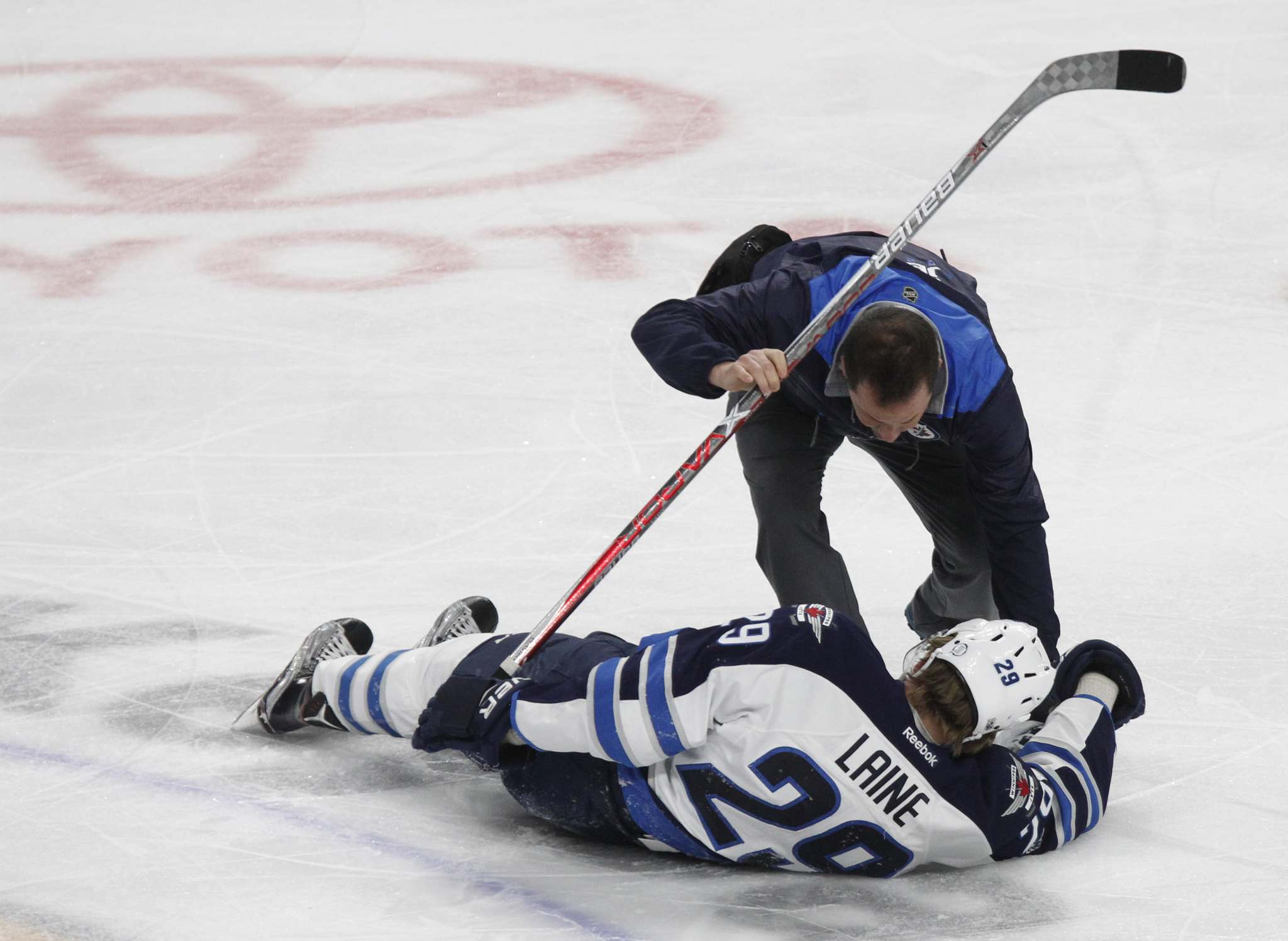 JEFFREY BARNES / THE ASSOCIATED PRESS</p><p>Patrik Laine is helped by a trainer after being hit during the third period in Buffalo.</p>